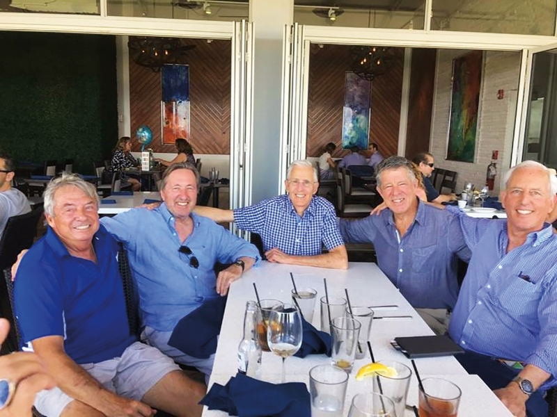 Formmates from 1961 (l. to r.) Chris Jennings, Stoney Stollenwerck, Jim Hatch, Bill Donald, and Mike Seymour donned their blue shirts for a luncheon at Oceans 234 restaurant in Deerfield Beach, Fla., in February.