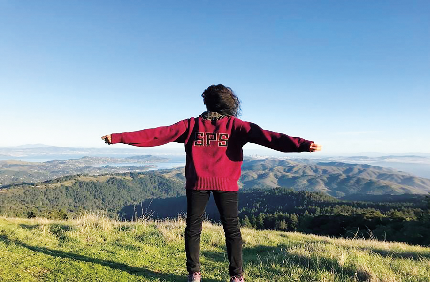 Sally Rousse '82 donning a classic SPS sweater and enjoying the view on top of Mount Tama, overlooking San Francisco.