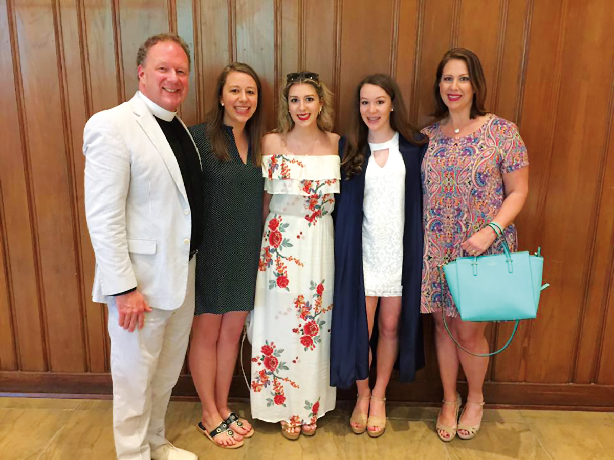 The Reverend Dr. John F. McCard '83 (l.), pictured here with his family, was installed as the 14th rector of the historic St. James's Episcopal Church in Richmond, Virginia.