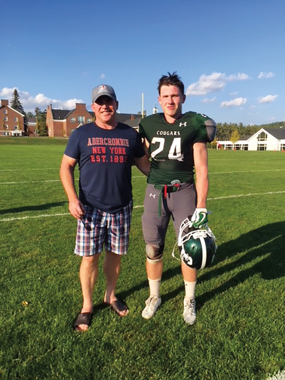 Cal Bussey '85 with his son, Malcolm, after a Cardigan Mountain School football game.