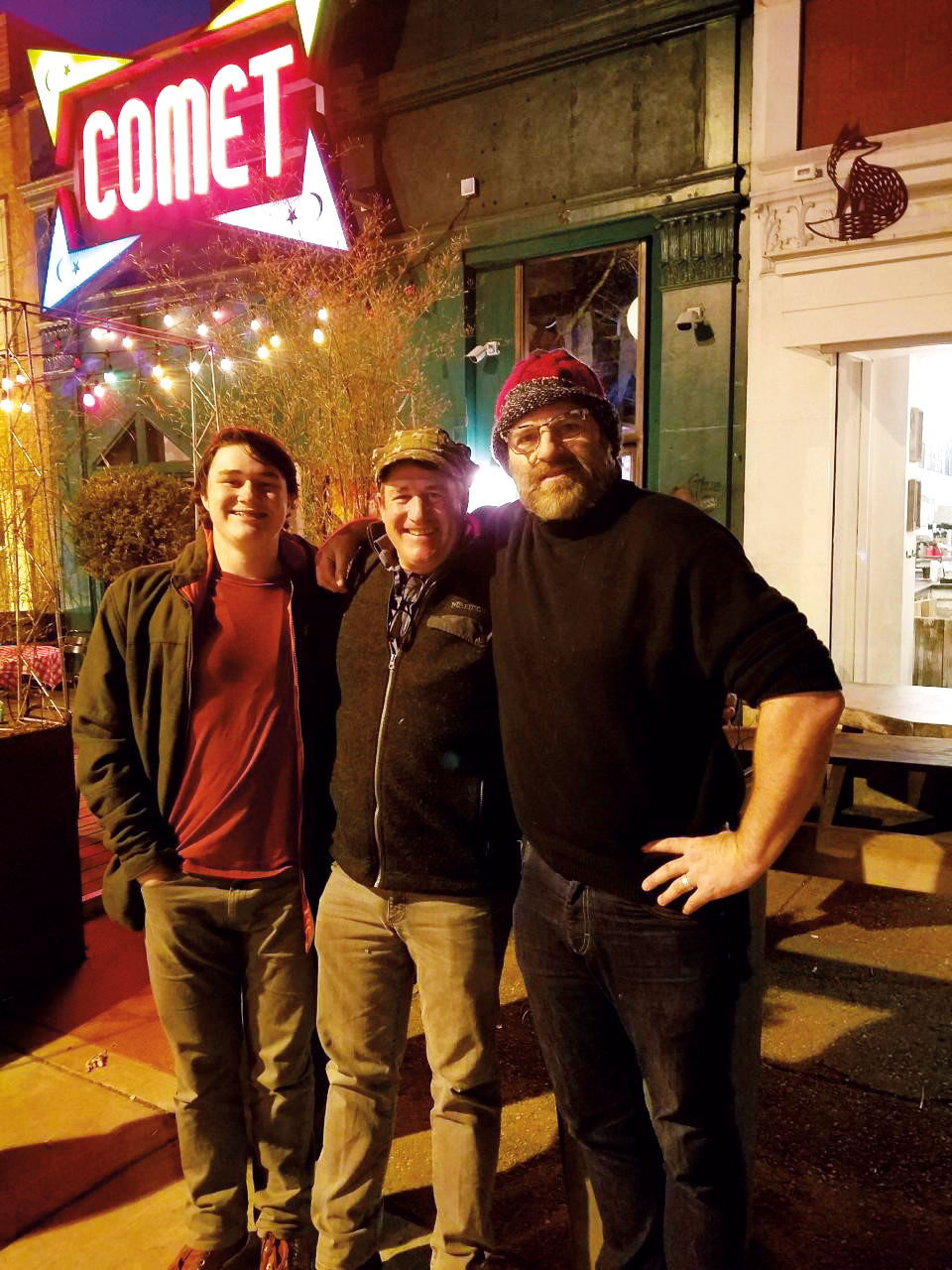 Nate Downey '85 (center) and son, Liam (l.) paid Andrew Corsello '85 (r.) a visit in Washington, D.C., in March.
