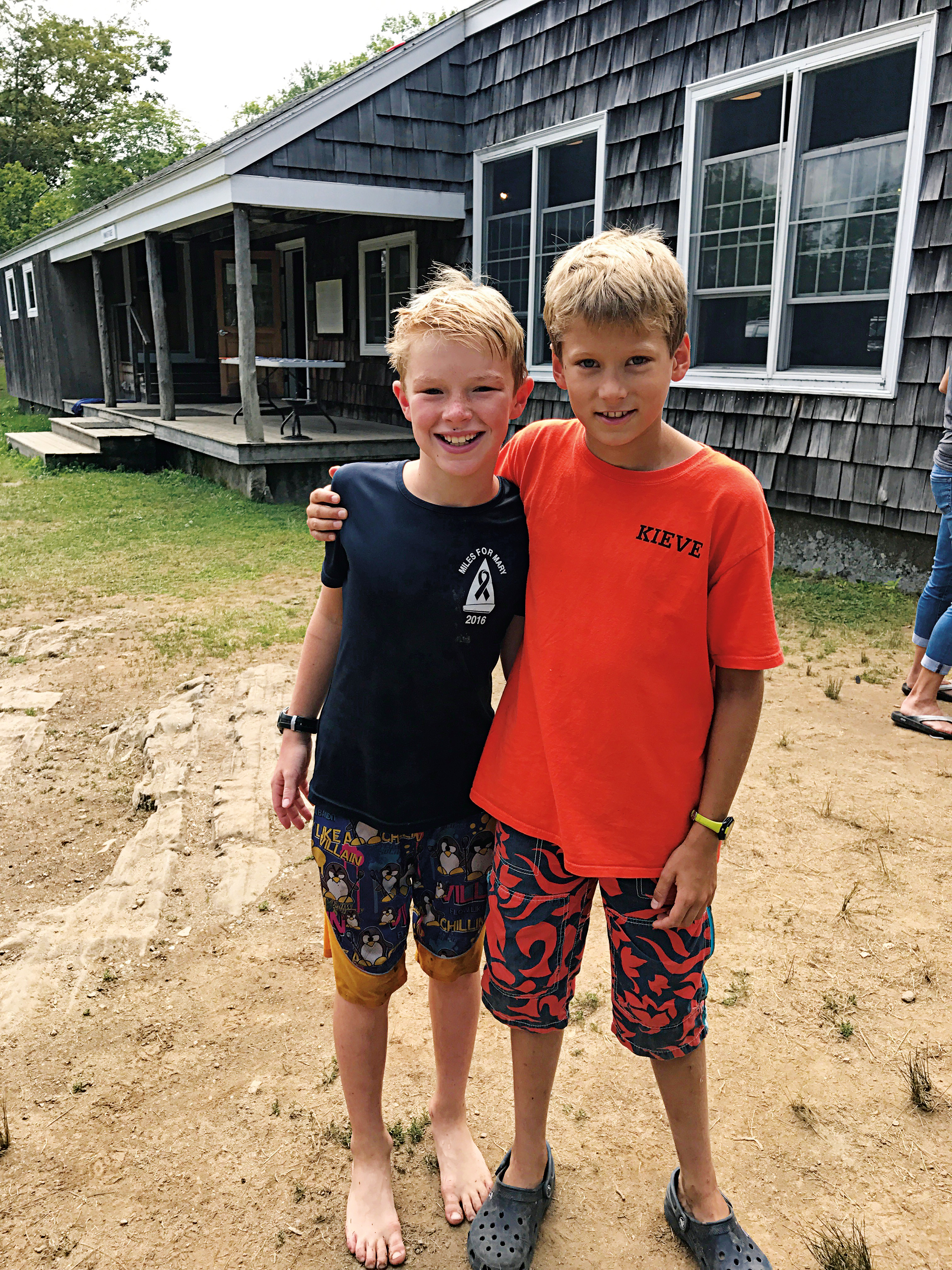 Whitman, son of Lydia Smyers '88, and Rowan, son of Zander Packard '88, at Camp Kieve in Maine.