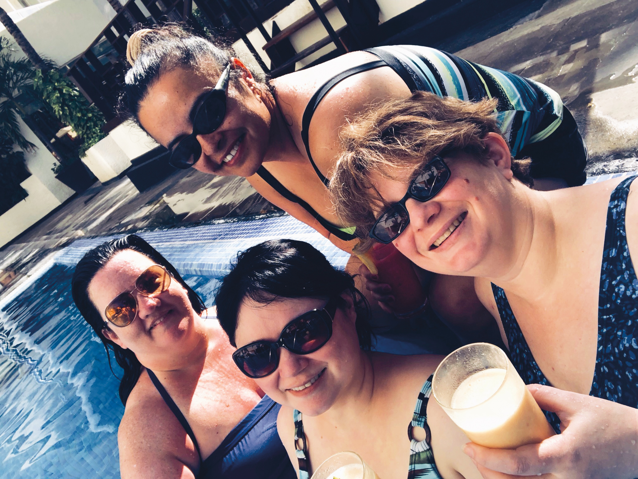 (L. to r.) Laurie Rockey '93, Lori Ann Sanchez '93, Heather Bragg '93, and Tania Montgomery '94 had a mini reunion in Cancun, Mexico.