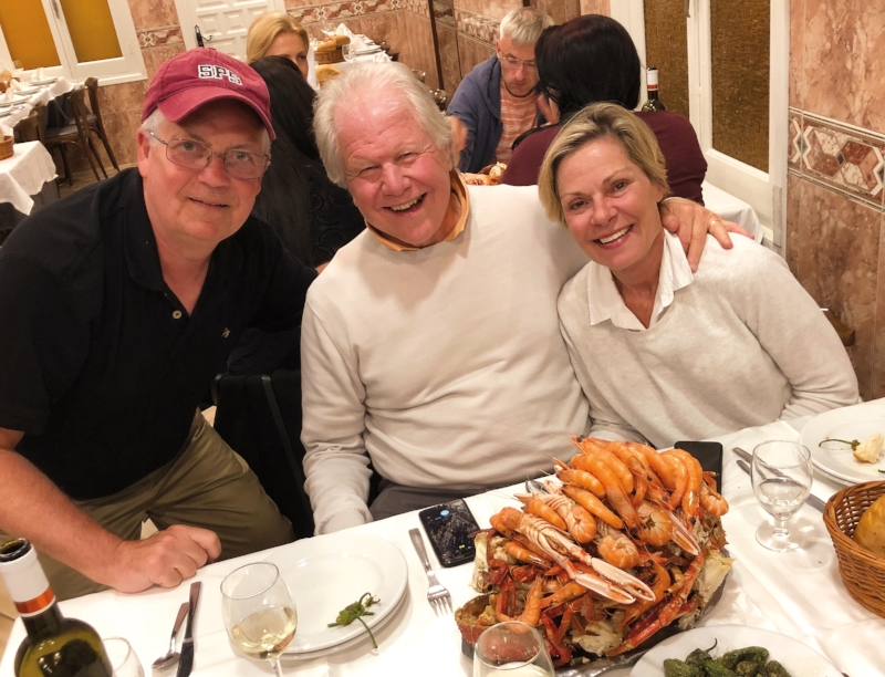 Fritz Newman '70 (l.), Lex Breckinridge '70 (c.), and Lex's wife, Zonnie, met for dinner in Spain.