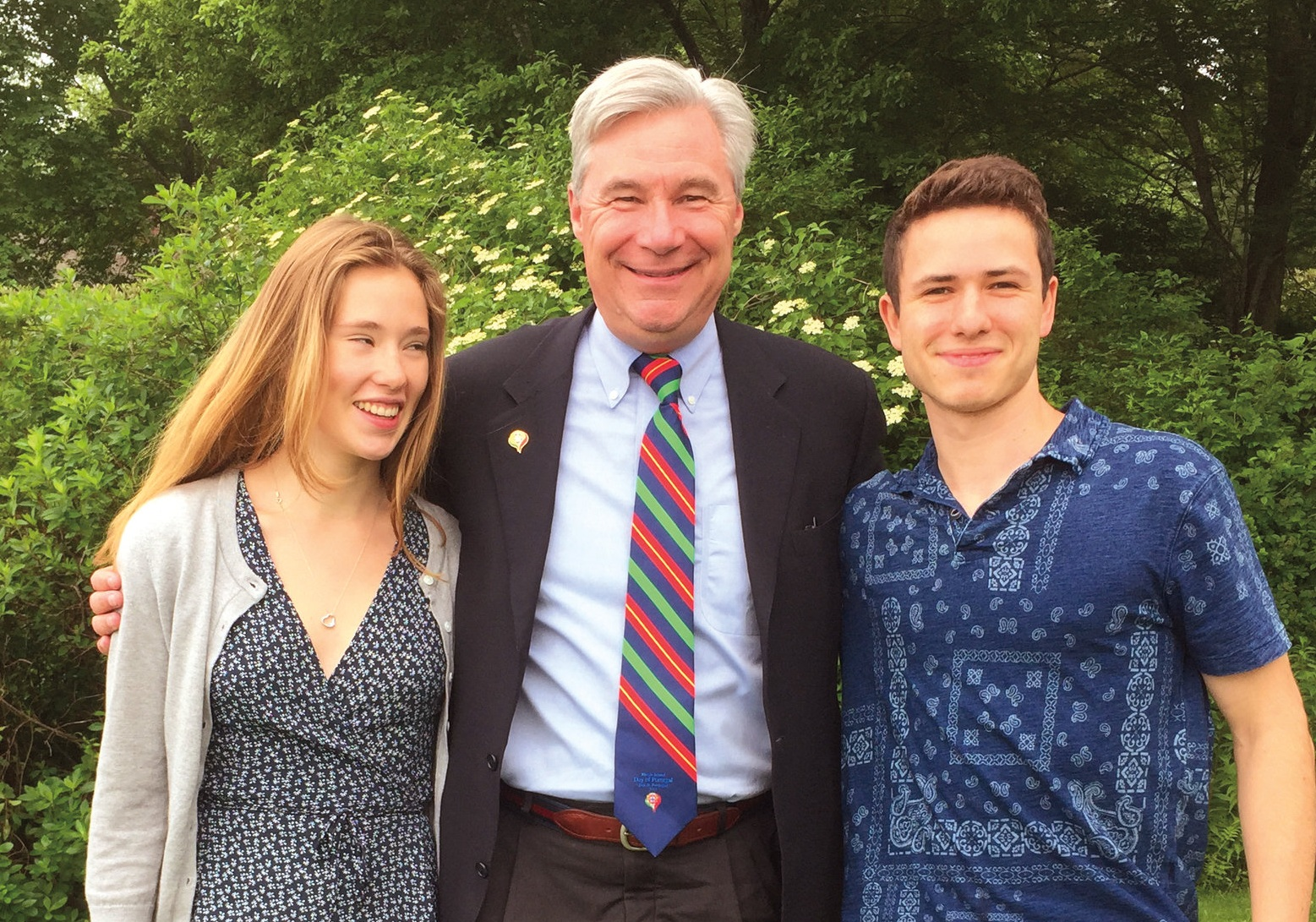 Georgia Channing '17 (l.), Santiago Saravia '17 (r.), and Sheldon Whitehouse '74 at a Saunderstown, R.I., fundraiser for Sheldon's U.S. Senate re-election.