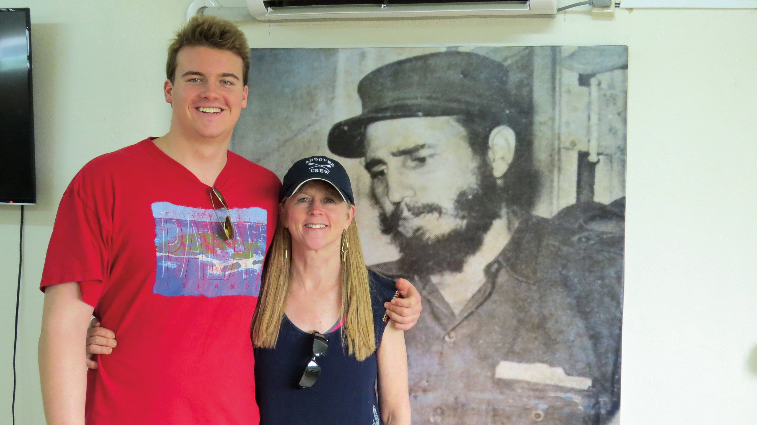 Helen Bouscaren '75 with son Travis, communing with Fidel in Cuba this summer.