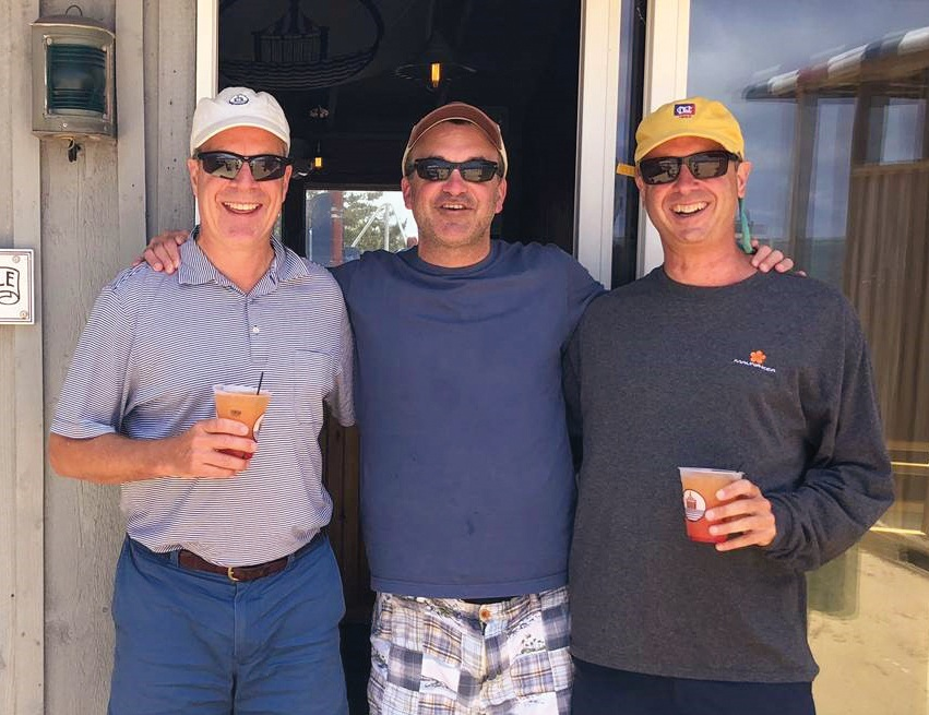 Formmates from 1980 (l. to r.) Mason Wells, Andrew Greenebaum, and Richard Walsh at Chappaquiddick Beach Club on Martha's Vineyard.