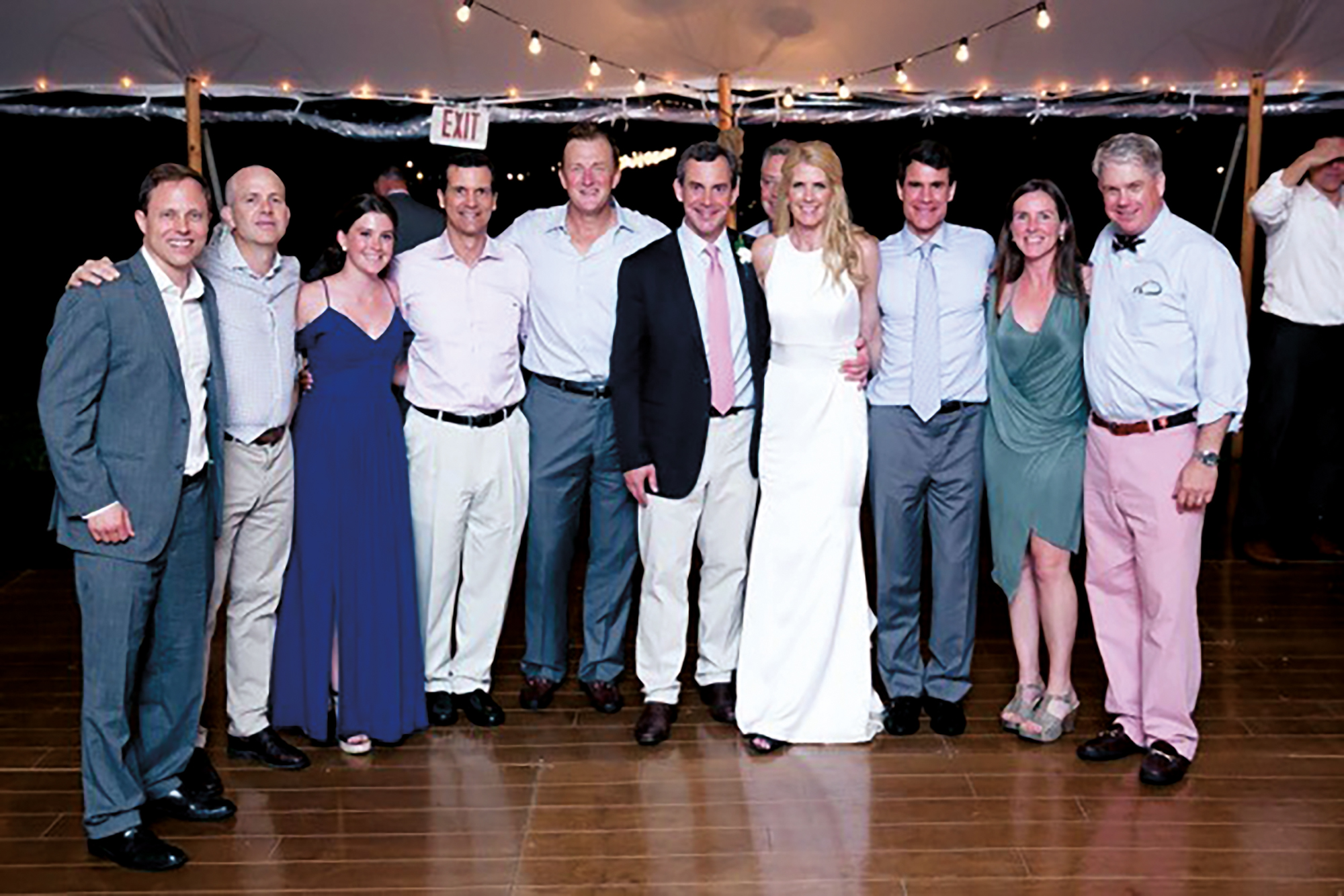 (L. to r.) Richard Baldwin '85, Sandy Osborne '89, Daphne Garrett '22, Lew Nash '85, Jack Rusher '85, Rob Garrett '85, Holly Sanderson Garrett '87, Johnsie Garrett '87, Melanie Shaw MacMillan '87, and Peter Paine '81 at the wedding of Rob and Holly.