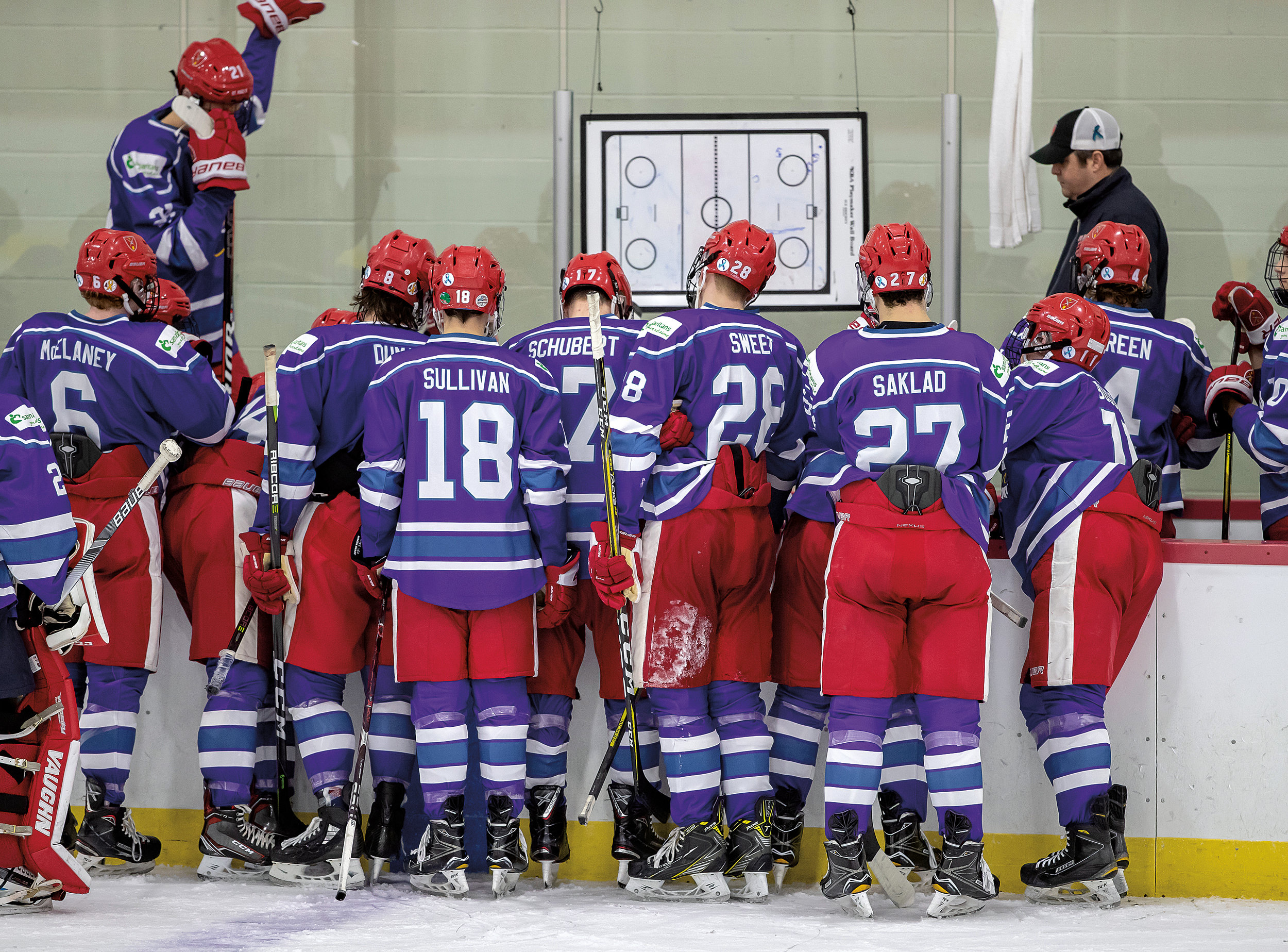 In support of Samaritans, members of the boys varsity hockey team wore purple jerseys against Andover on January 18.