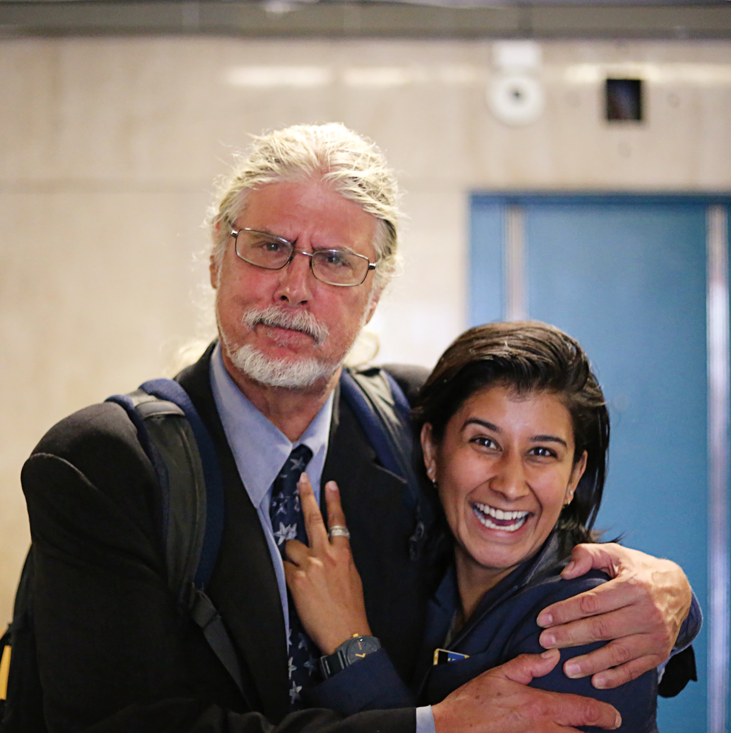 Trivedi (r.) with her law partner and mentor, Ron Kuby.