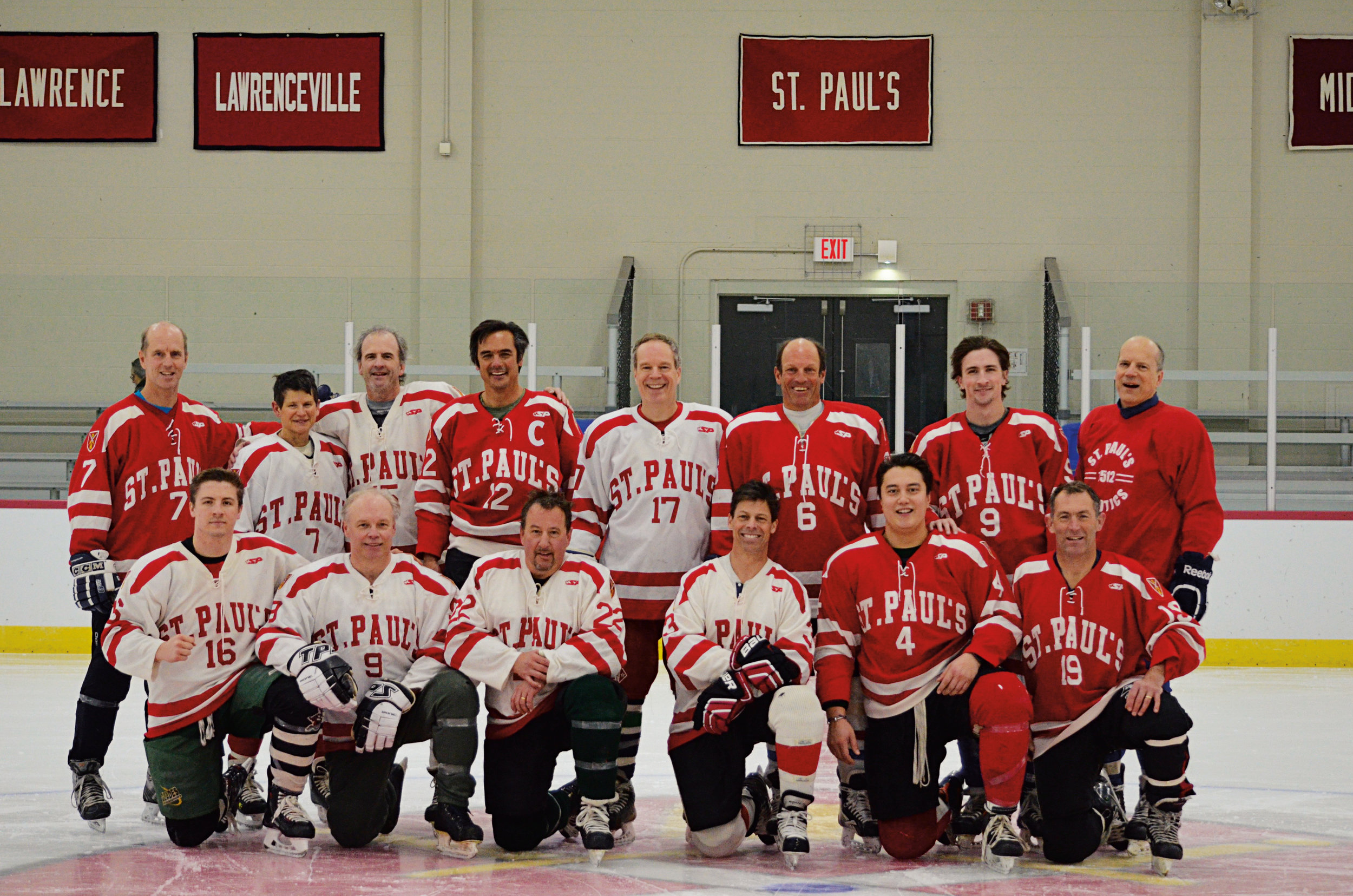 "Alumni Hockey Game players, standing (l. to r.): John Potter '85, Elisabeth ""Wyz"" Mooney '78, Jon Old '78, John Bohan '83, Mason Wells '80, Clay Yonce '82, Colin ""Brodie"" McCusker '12, Terry Wardrop '78. Front (l. to r.): Cam McCusker '14, James Hornblower '82, Christopher King '82, Jim Barker '87, Sam Hudziak '12, and Bill Kessler '87. (Goalies, not pictured, were faculty members Scott Reynolds and Darik Velez ASP '96.)"