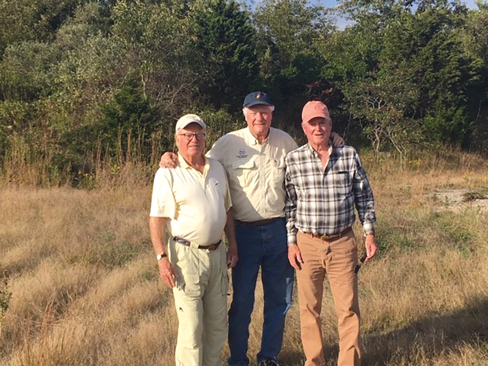 Form of 1959 friends (l. to r.) Speedy Mettler, Sydney Waud, and Coley Burke celebrating their 52nd fishing trip.