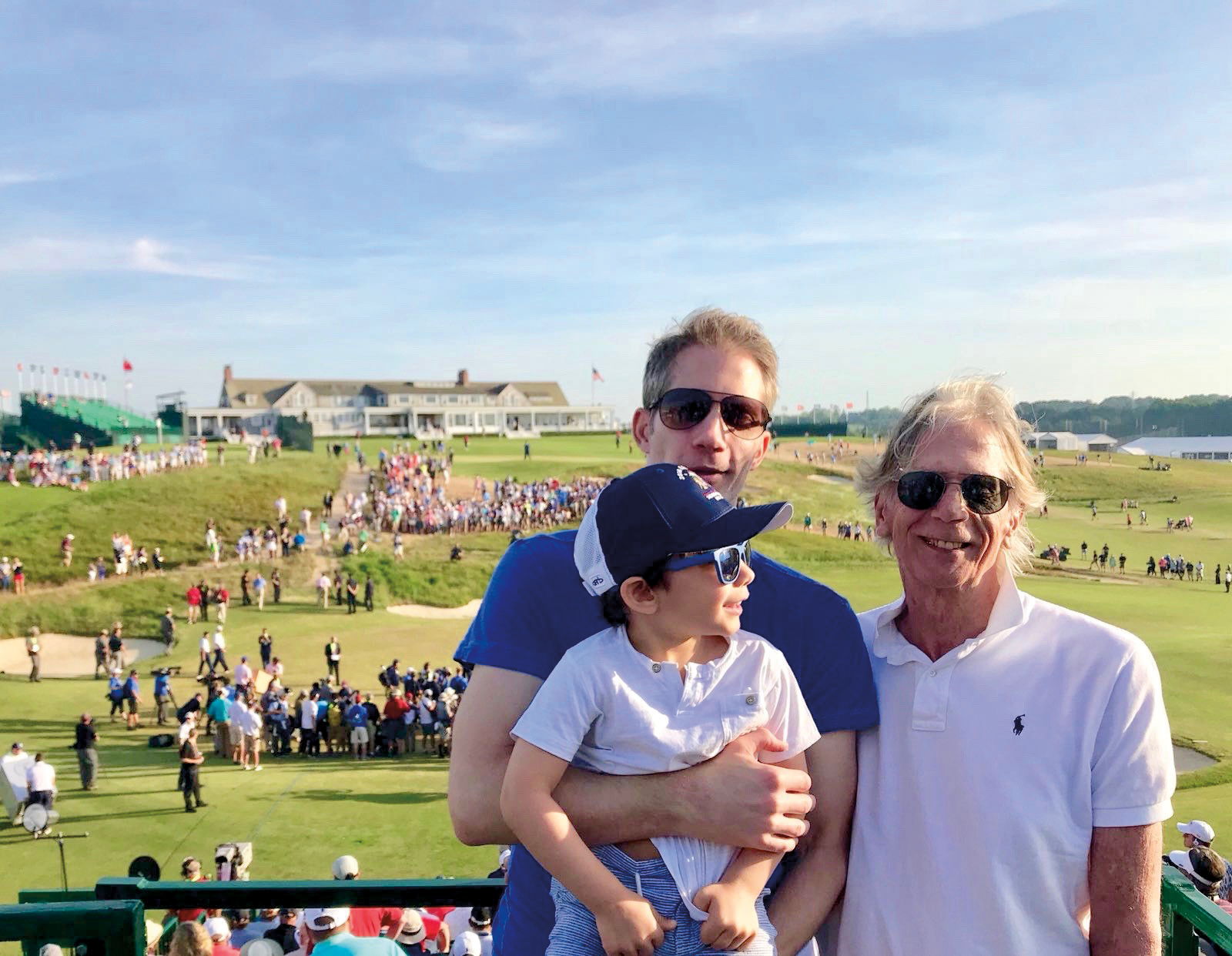 Erik McKee '95 (l.), Sellers McKee '64, and Thomas McKee spent Father's Day at the 2018 U.S. Open.