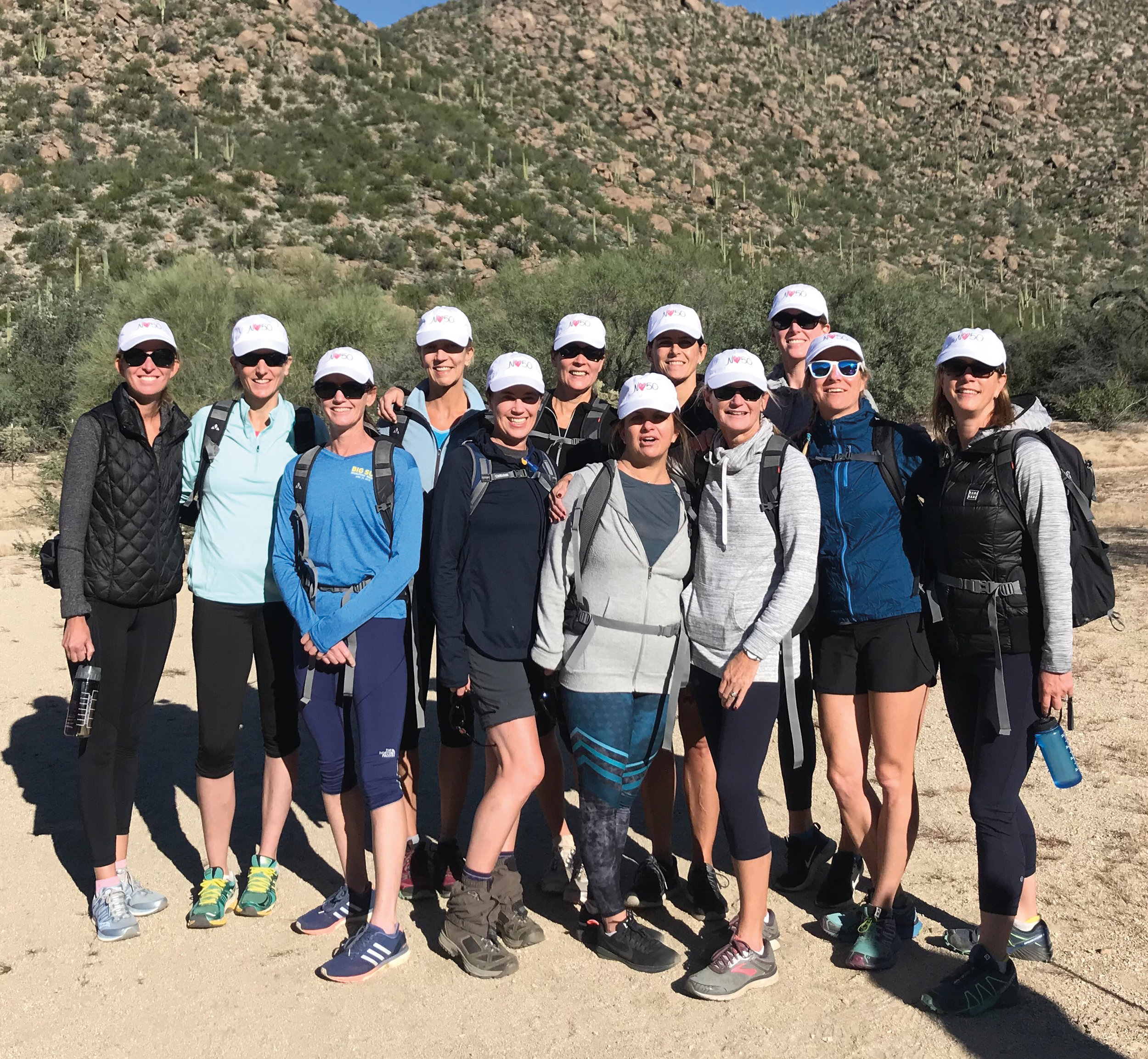 1986 formmates (l. to r.) Nina Ward, Emily Day, Amy Sullivan, Lisa Faber, Abby Walsh, Jill Forney, CeeCee Belford, Beth Lyman, Sarah Whittle, Pam Lloyd, Kathy Kuhn, and Tracy Barsotti came to Arizona for Sullivan's 50th birthday hike.