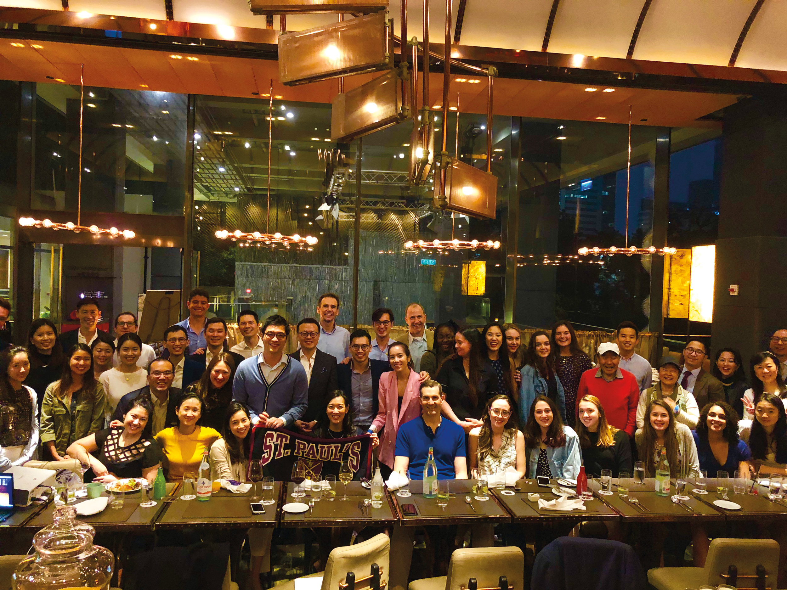 Julian Cheng '92 hosted a Thanksgiving meal for Paulies in Hong Kong, including the visiting SPS volleyball team.