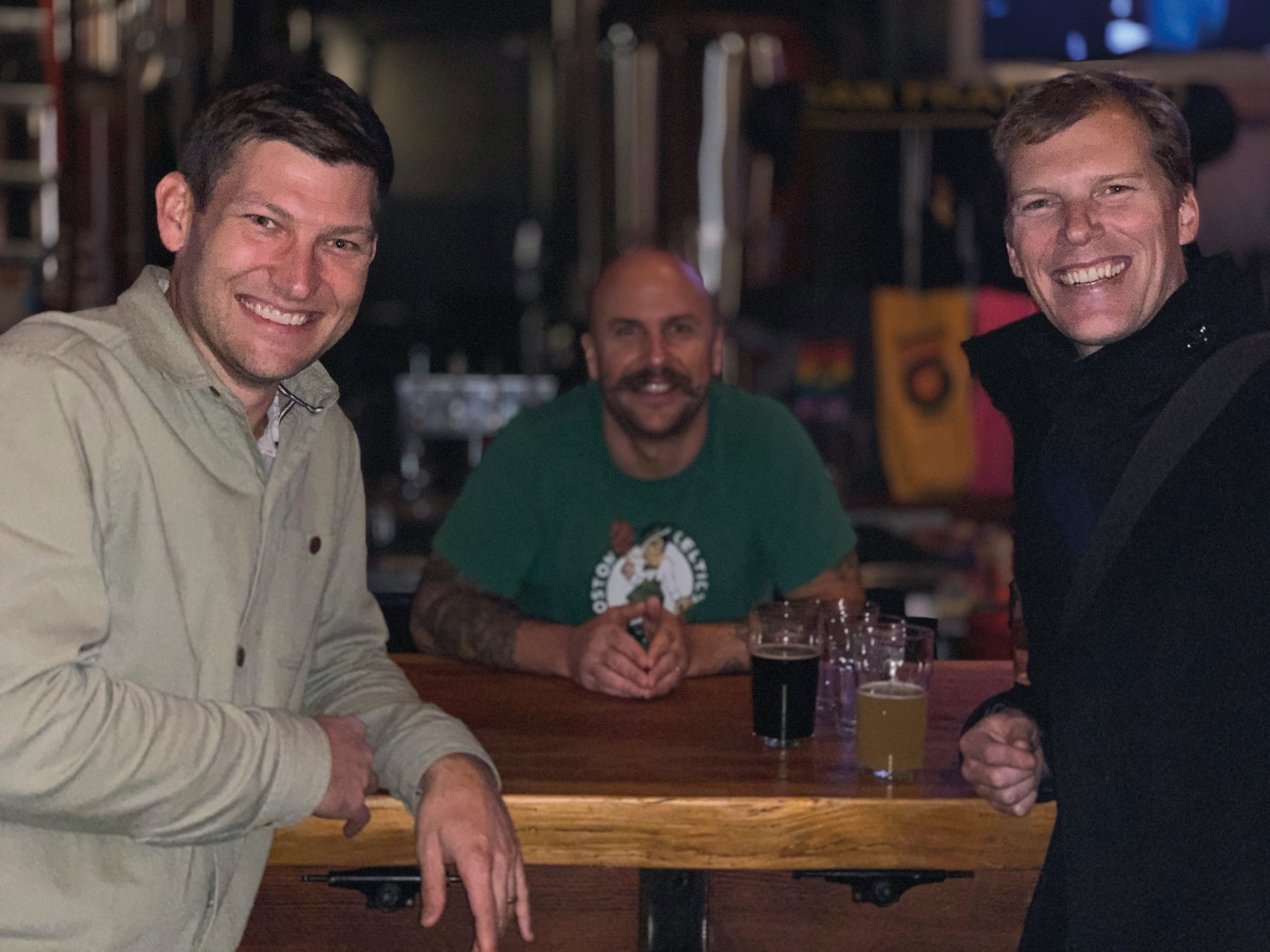 (L. to r.) TJ Leonard '97, Mark Devito '99, and Jamie Funk '97 at Mark's brewery, Standard Deviant.