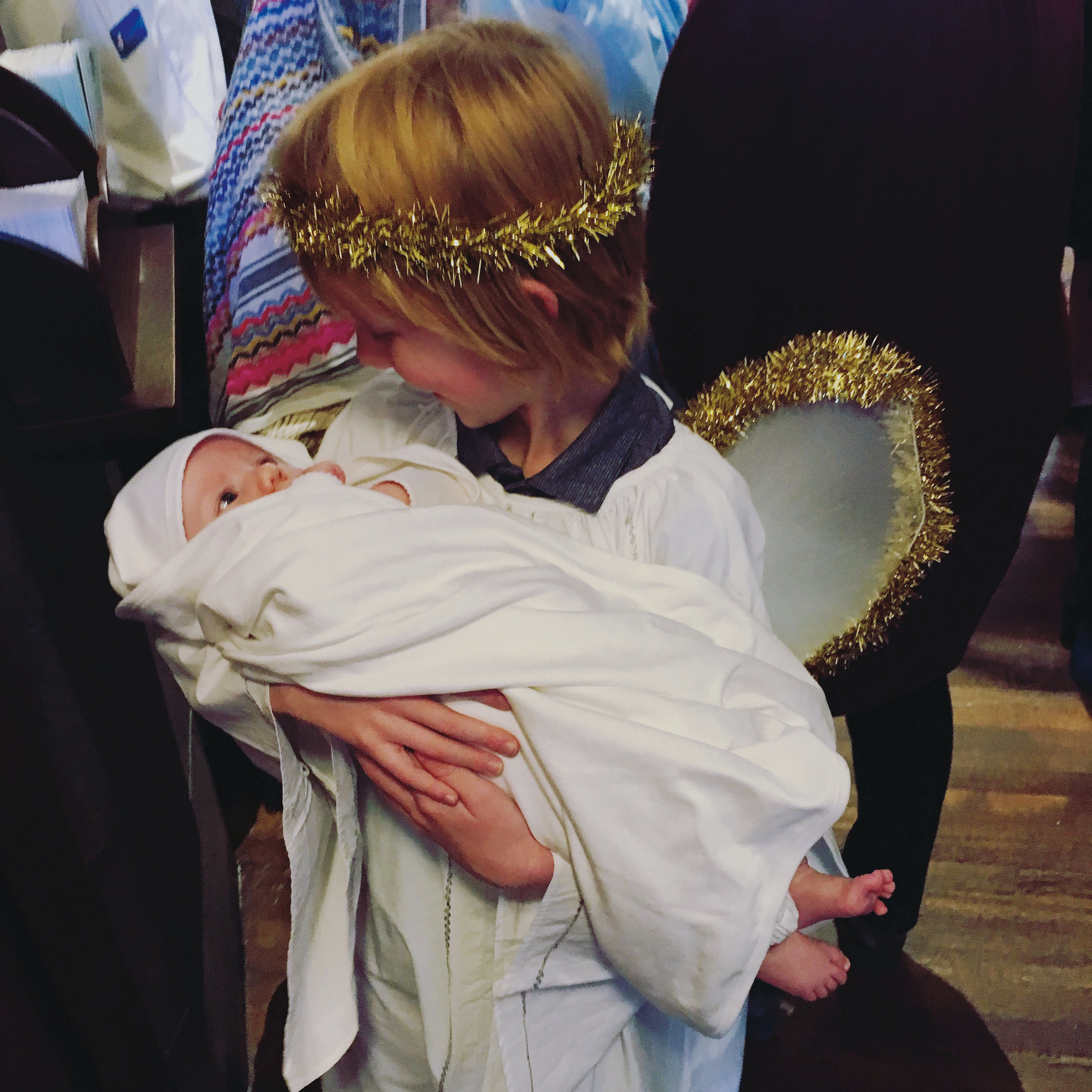 Andrew Stehli Howell (baby Jesus), son of Sarah (Stehli) Howell '97, with his older brother, Lucius.