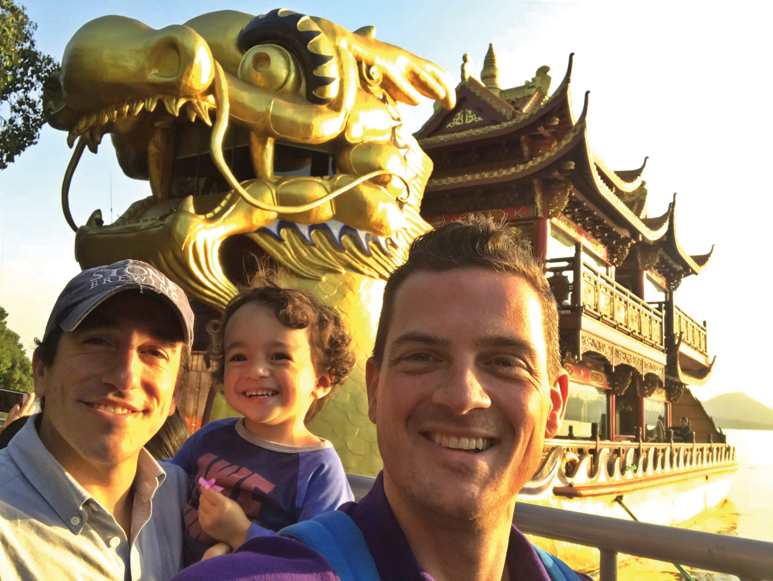 Paul Gelinas '99 (l.) and his son, Thomas, with Dodd Loomis '98 in Hangzhou, China.