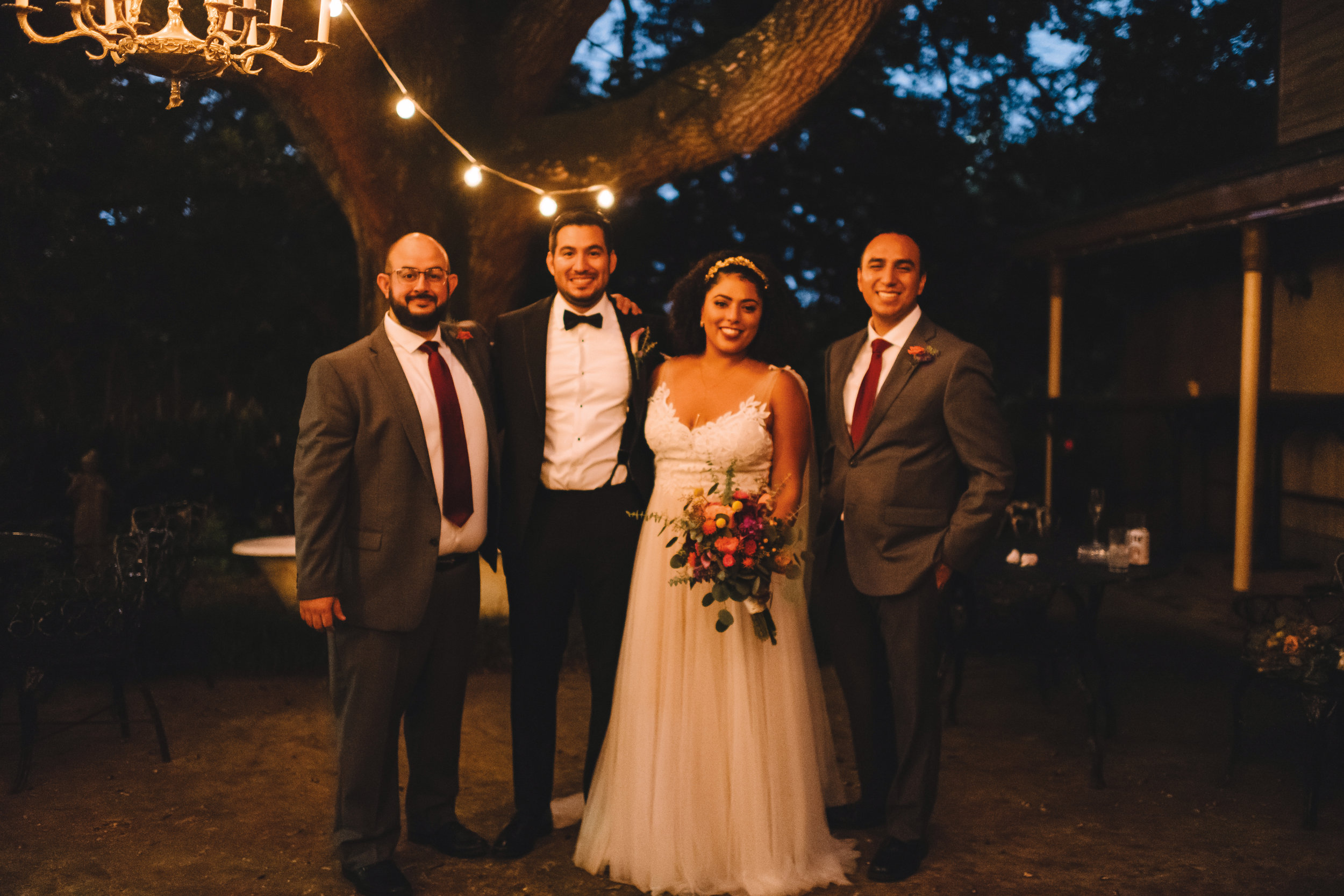 Ulysses Hernandez '07 (second from left) married Ariana McLean in New Orleans in October with formmates Oliver Morfin (l.) and John H. Montalvo (r.) as groomsmen. .