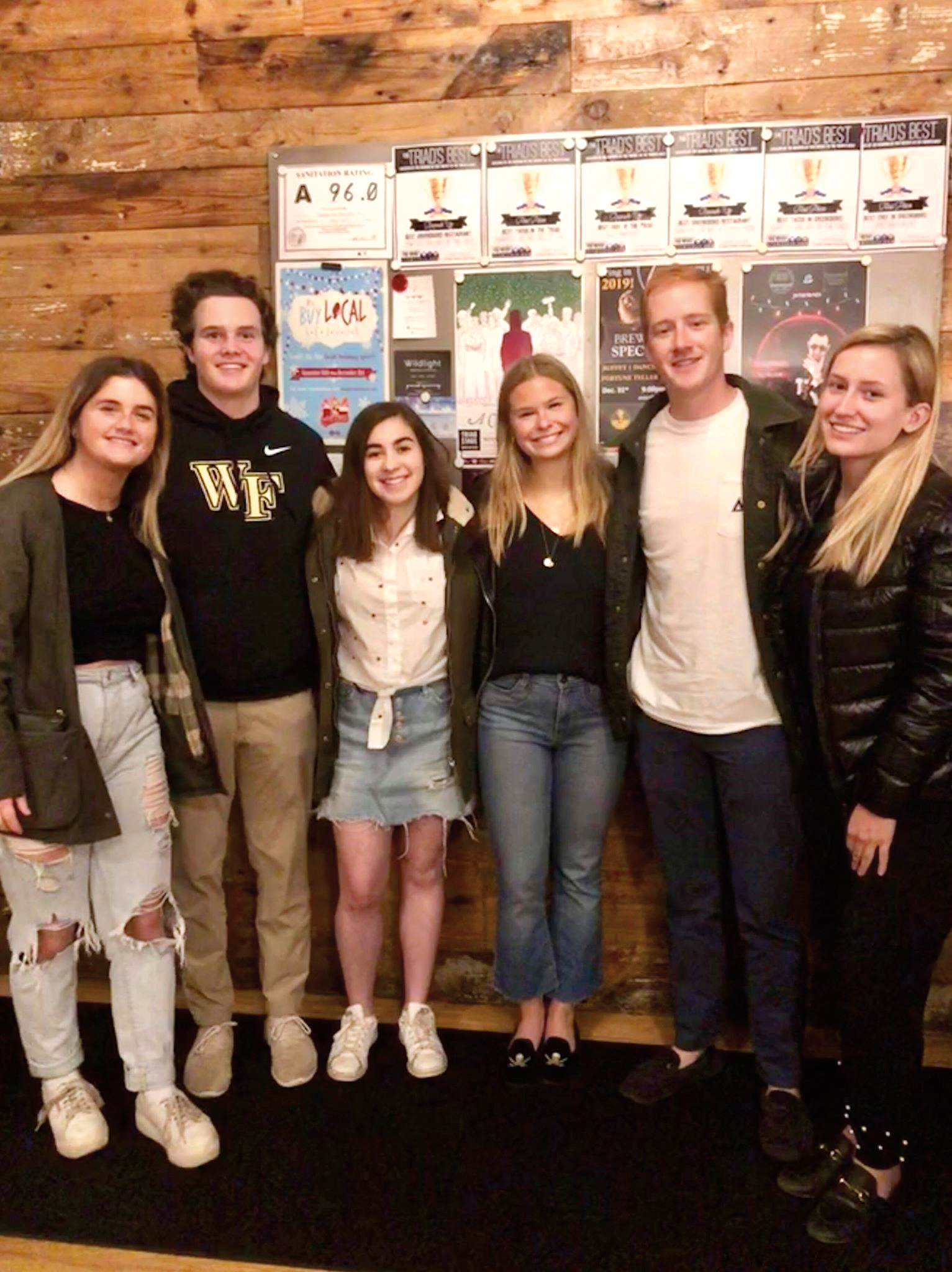 (L. to r.) Avery Van Ingen '18, Kemp Taylor '18, Lauren Neal '18, Libby Lloyd '15, George Hamilton '15, and Mary Eliot Stone '17, all students at Wake Forest, met for dinner in December.