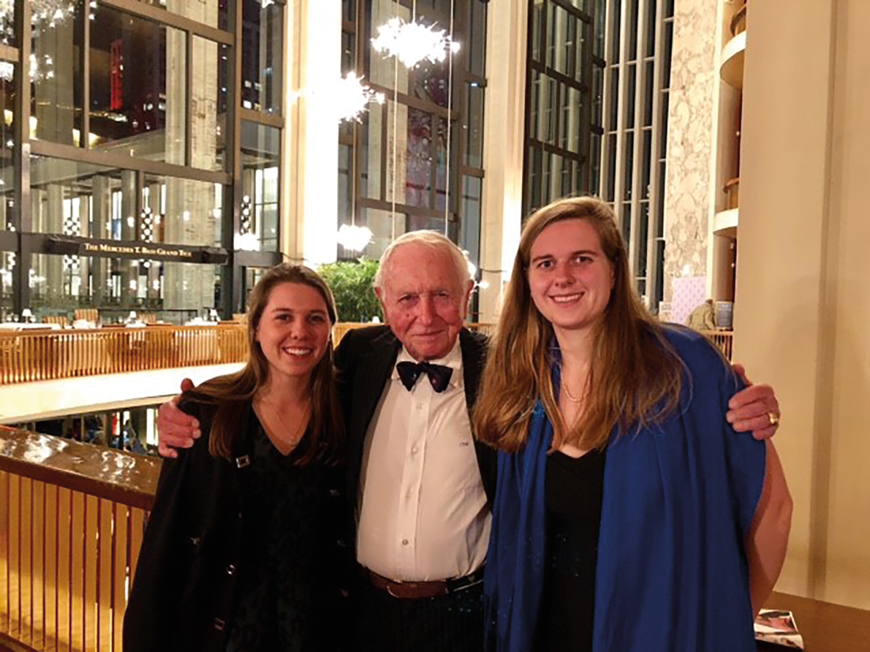 Jim Kinnear '46 celebrated Grand-daddy's night at the Met Opera with granddaughters Stacy Neul '15 (l.) and Stephanie Neul '11 (r.).