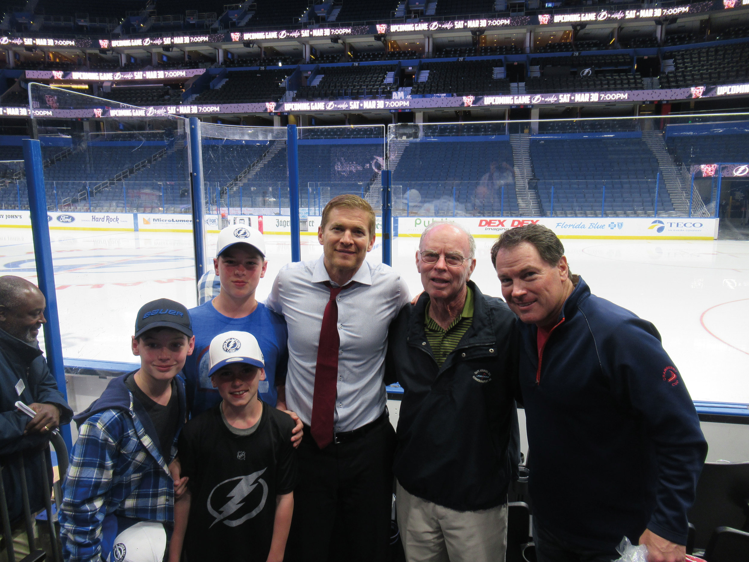 Brendan, Drew, Will, Billy '86, and Bill Matthews '61 with Jeff Halpern '94 at a Boston Bruins vs. Tampa Bay Lightning hockey game.