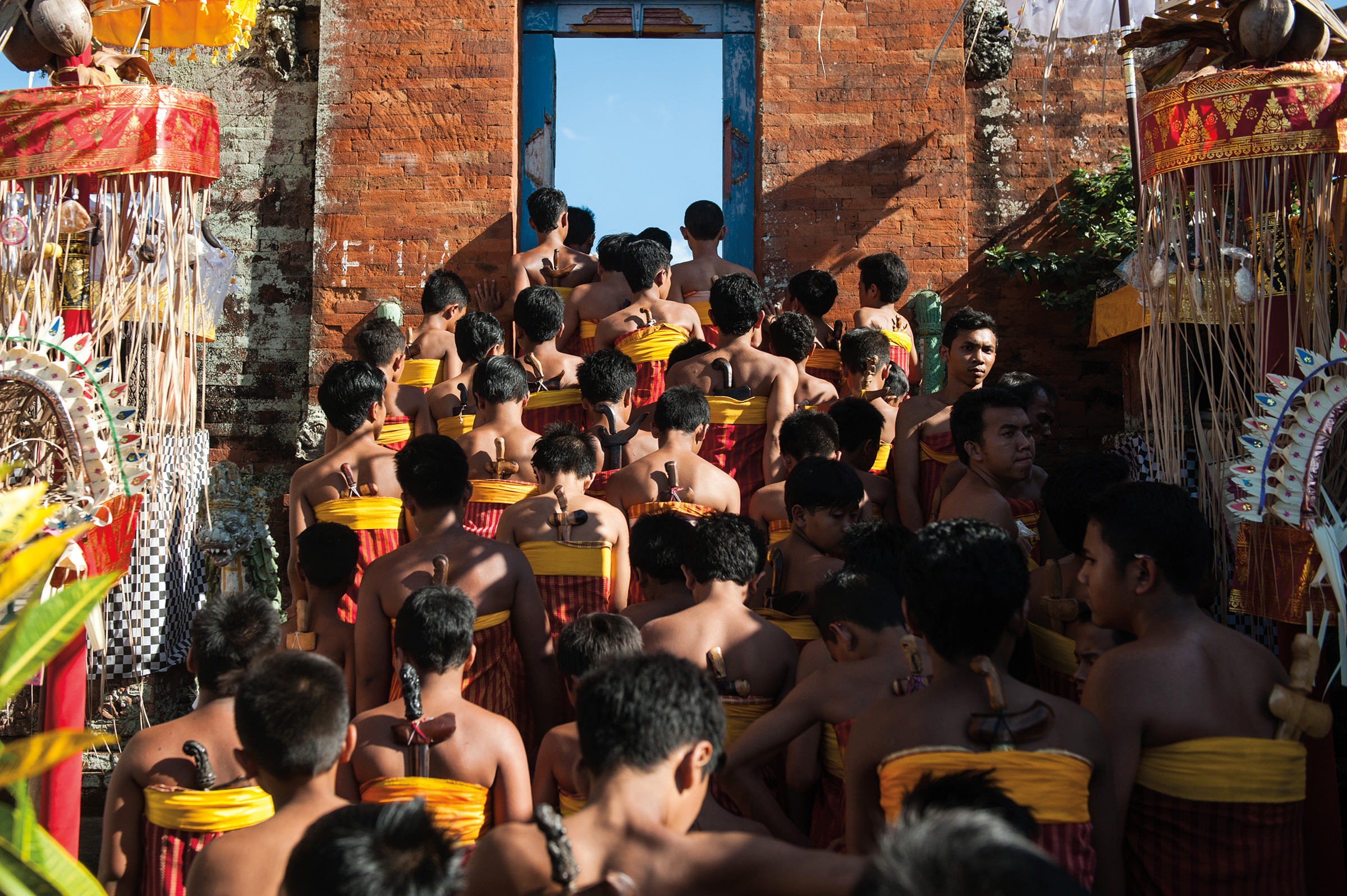 David Irons '64 witnessed teenage boys taking part in a coming-of-age ceremony at a village temple in East Bali.