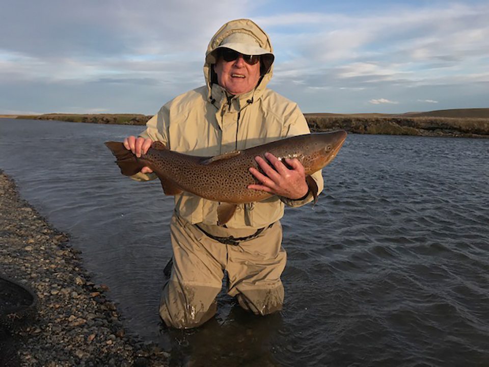 Hugh Clark '53 with a 20-pound brown trout on the Rio Grande River in Tierra del Fuego, Argentina.