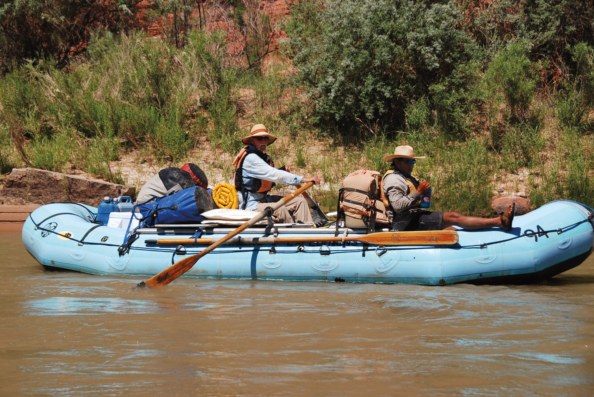 David Noble '57 rowing on the San Juan River in Utah with Hopi archaeologist Lyle Balenquah.