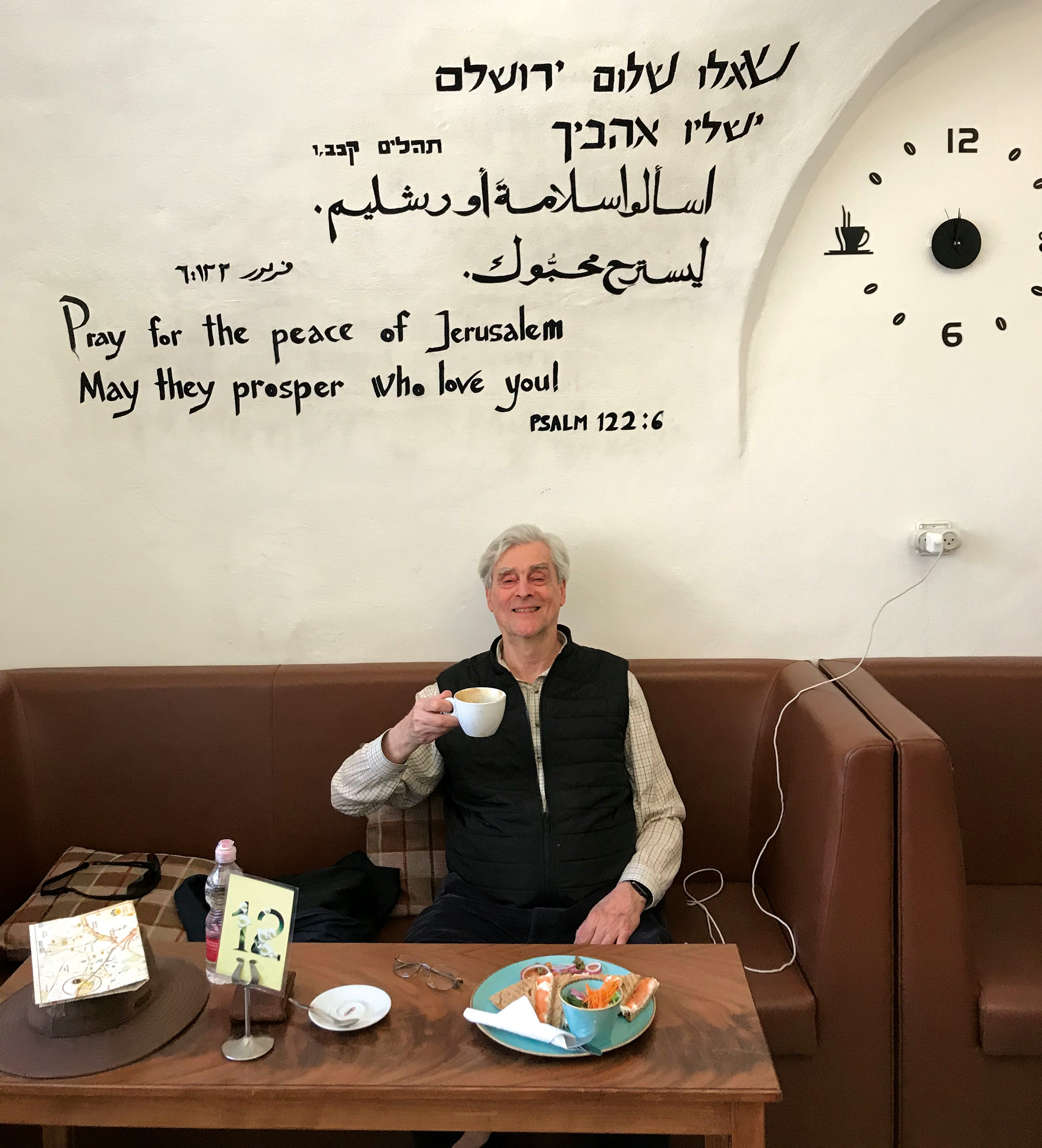 "Tom Bartlett '57 recalling the hymn sung at SPS, ""O Pray for the Peace,"" while at a café in Jerusalem's Old City."