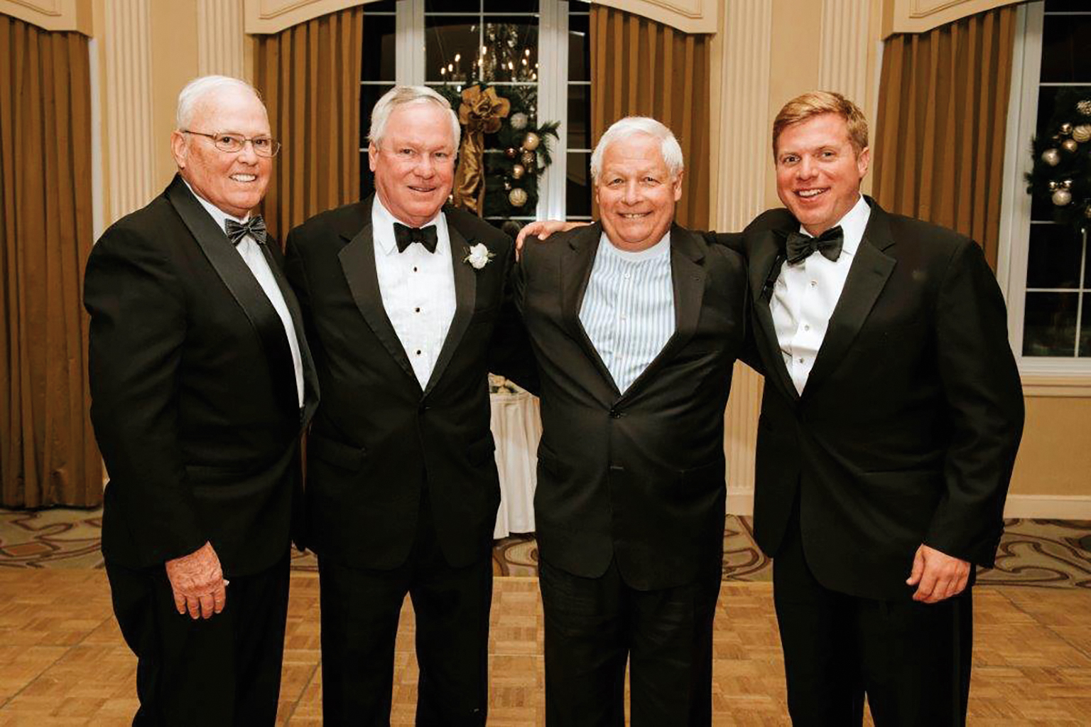 (L. to r.) Rick Billings '65, Harry Billings '67, John Branson '67, and Ed Ross '05 at the wedding of Harry's daughter in Boston.