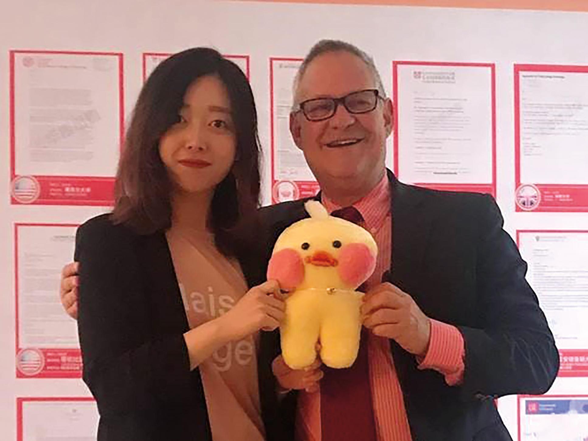 Lin Giralt '72 promoting school programs in China.