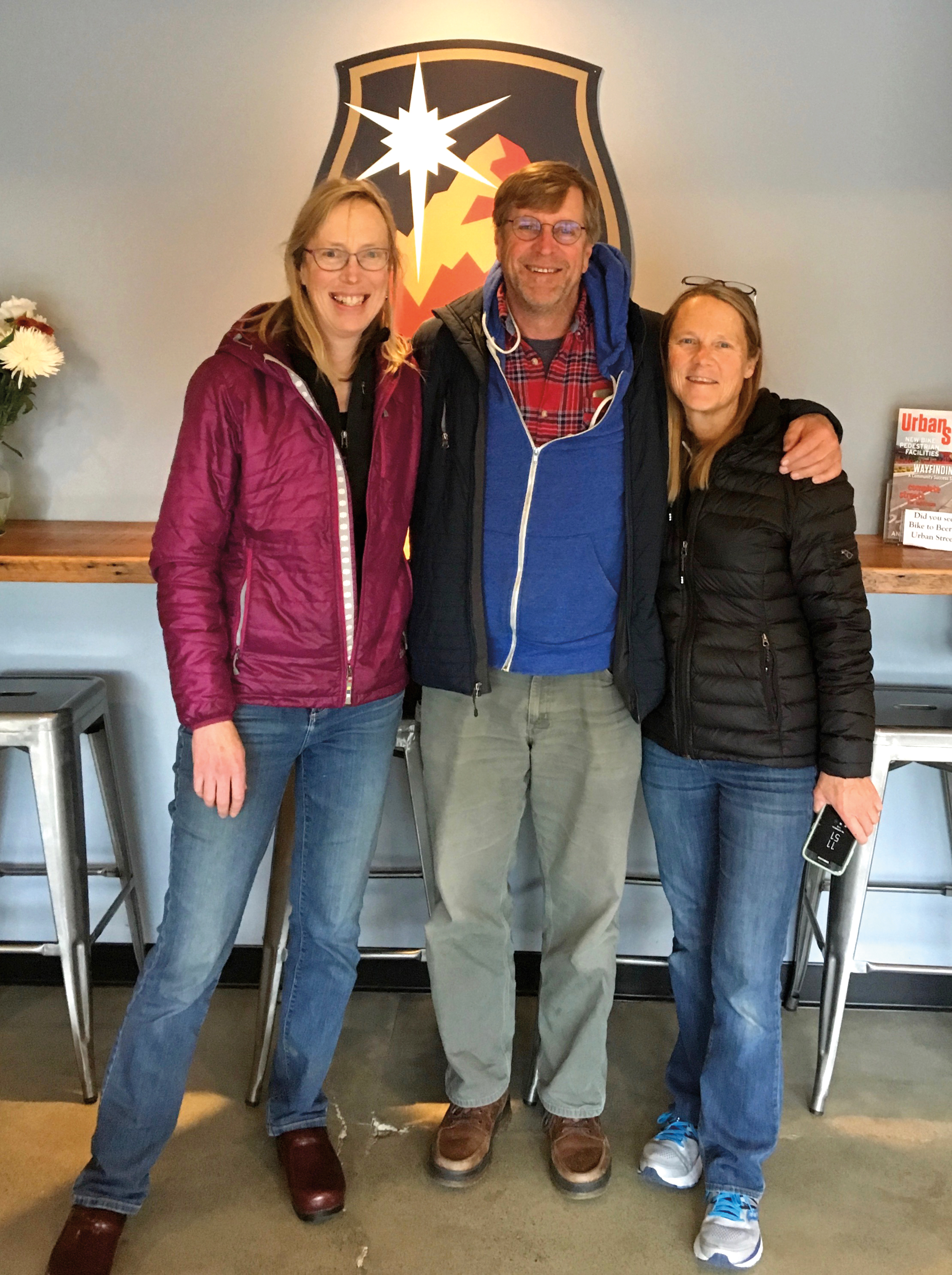(L. to r.) Cappy Lewis '76 with husband Brett Lewis '77 and Cindy Drinkwater '77 at Cynosure Brewing in Anchorage, Alaska.
