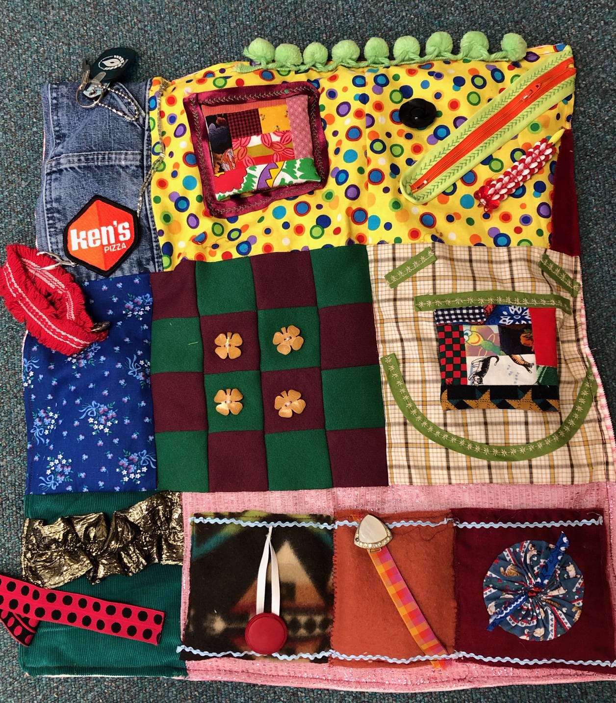 Fidget Blanket by Margaret Jones (90 year old member of First Presbyterian Church). Hear more on Margaret's involvement in the featured video (right).