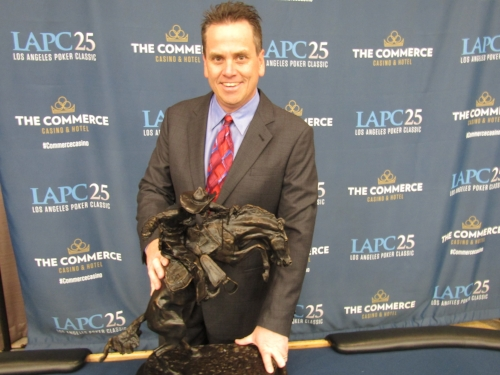 COMMERCE CASINO TOURNAMENT DIRECTOR MATT SAVAGE WITH THE TROPHY