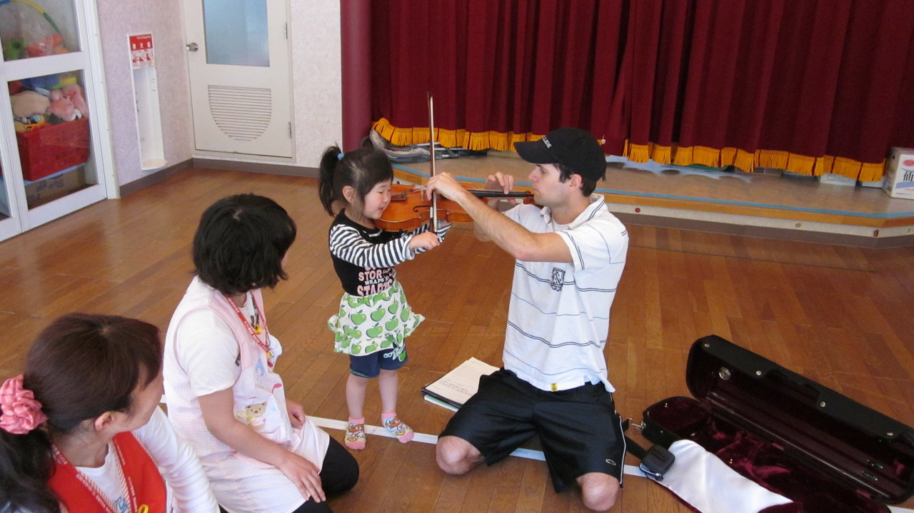 Taking a music break with Hotel Kanyou staff and school teachers