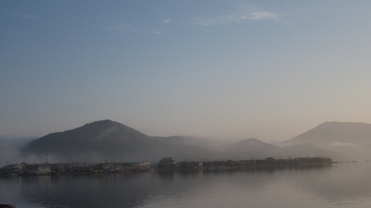 Fog rises over damaged parts of Ishinomaki