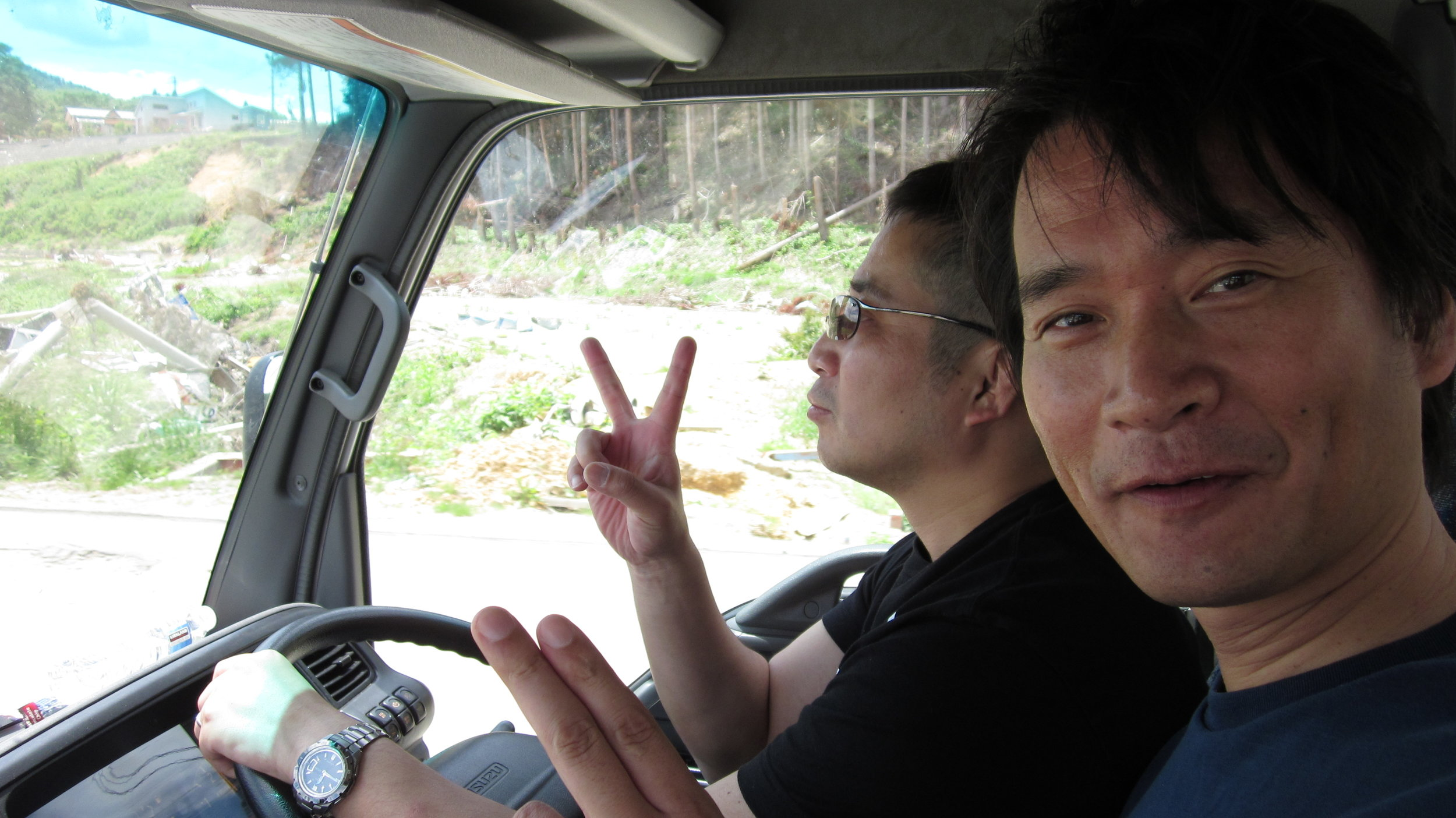 Two firefighters from Yamagata who spent a day volunteering with O.G.A. for Aid in Minamisanriku