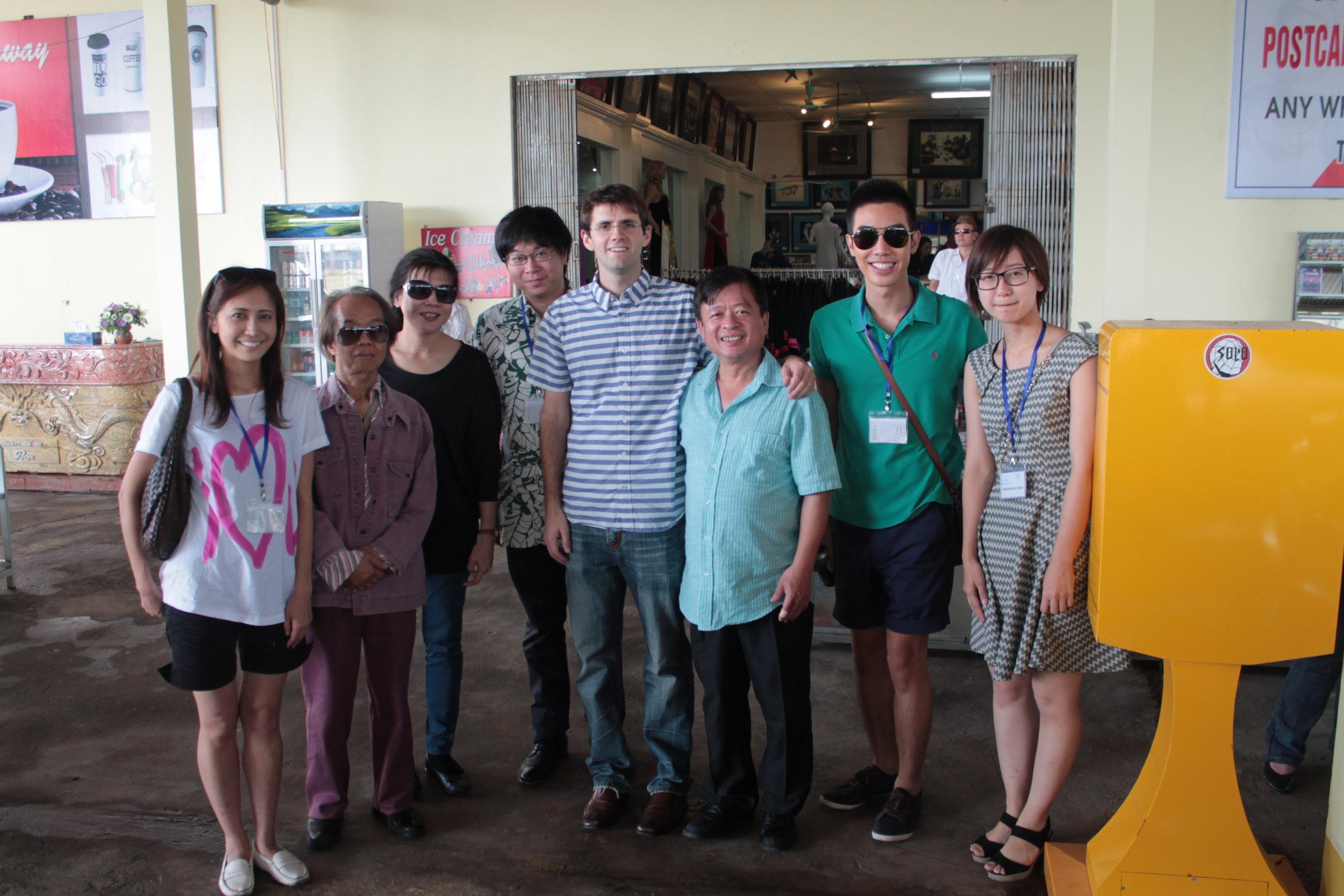 AANMI team members Sayo Kosugi, Kah Chun Wong, Rain Senavinin, and Ayane Sato pose during a roadside pit stop with composer Nguyễn Thiên Đạo and festival organizer and composer Đỗ Hồng Quân.