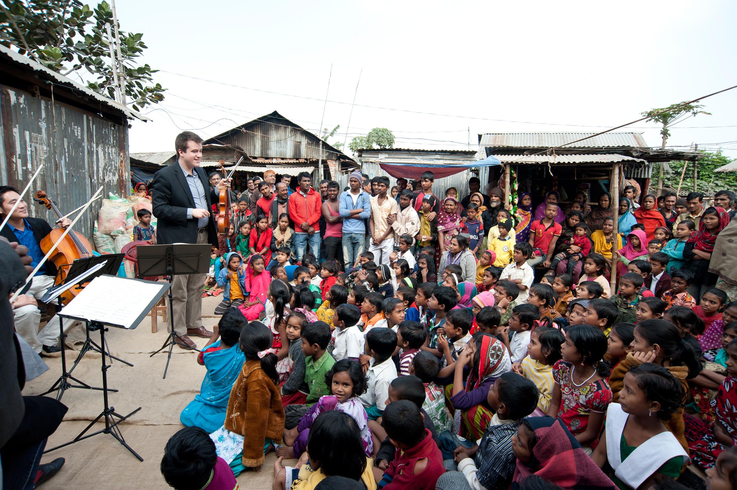 Will Frampton explains about his instrument, the viola, to BDP students in Dhaka. Photo by Shinobu Suzuki.