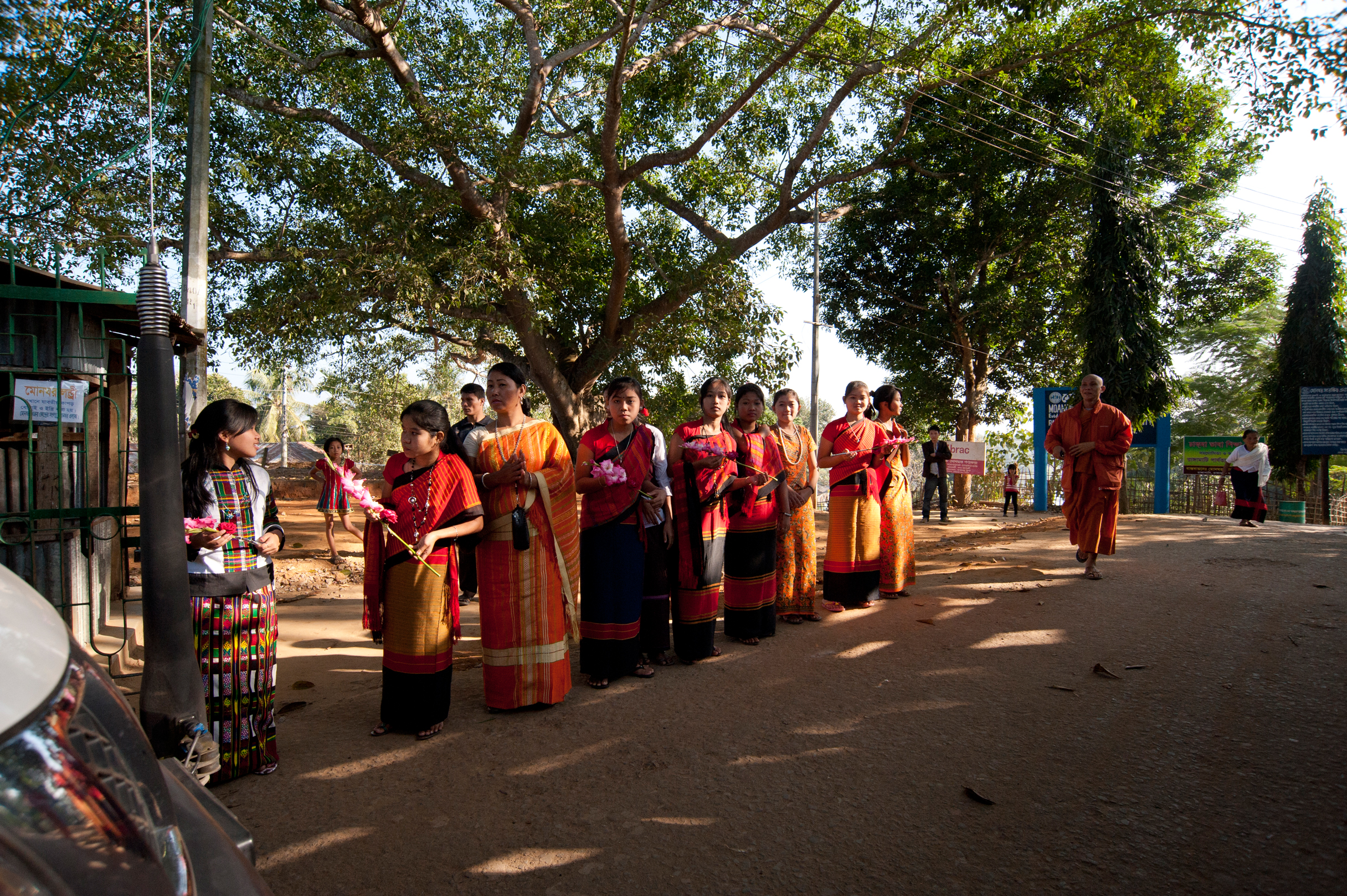 A colorful welcome – students of Moanoghar await our arrival, wearing traditional Chakma (and other tribal) attire. Photo by Shinobu Suzuki.