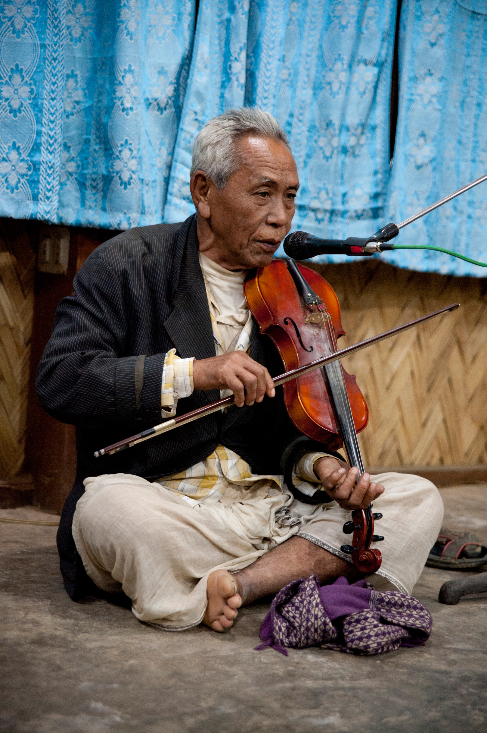A Chakma tribesman performed his fiddle for us during dinner on Christmas Day, 2012. He is one of the last who continues the Chakma tradition of epic storytelling through music. Photo by Shinobu Suzuki.
