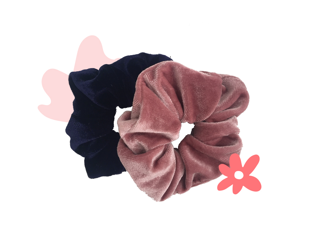 A Clarence and Co. velvet scrunchie in Midnight Blue.