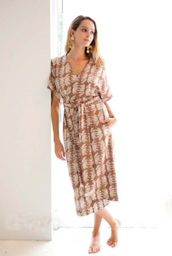 6. a wrap dress - Wrap dresses are just so easy. Our wrap dress has a pretty tropical pattern and is spun from cotton.