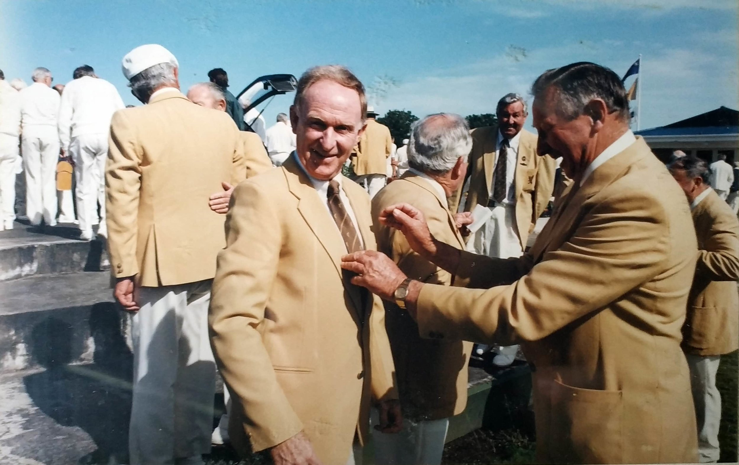 Sir Murray Halberg trying on his blazer. Sir Murray is a long distance runner that won gold at the 1960 Olympics for 5000m, and is the founder of the Halberg Disability Sport Foundation. Photo credit: Royal Oak Bowls. 1992.