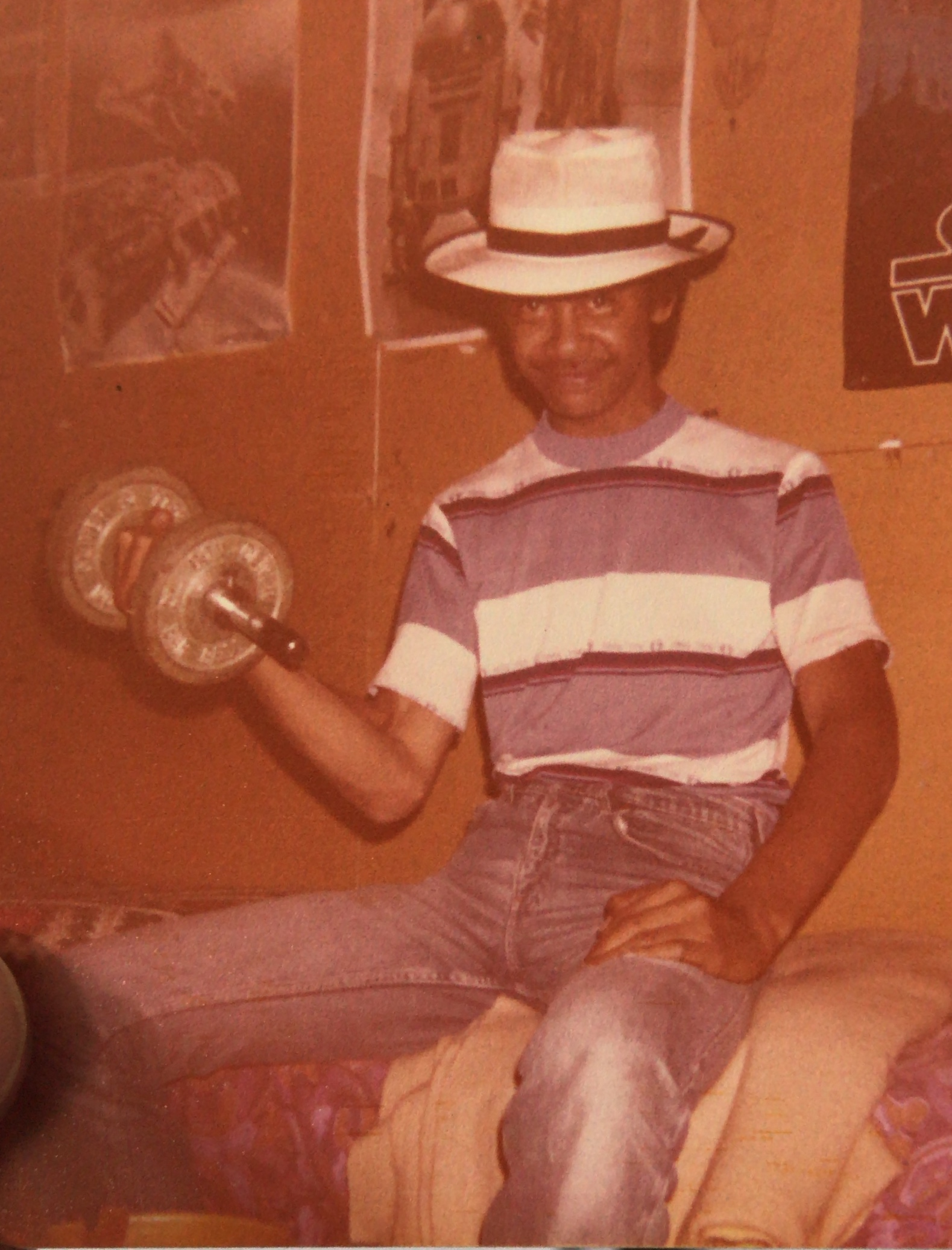 Uncle Vincent doing some curls in the garage at the Timo family homestead, Avondale Road. Image Credit: Dayne Smith. Late 1970s.