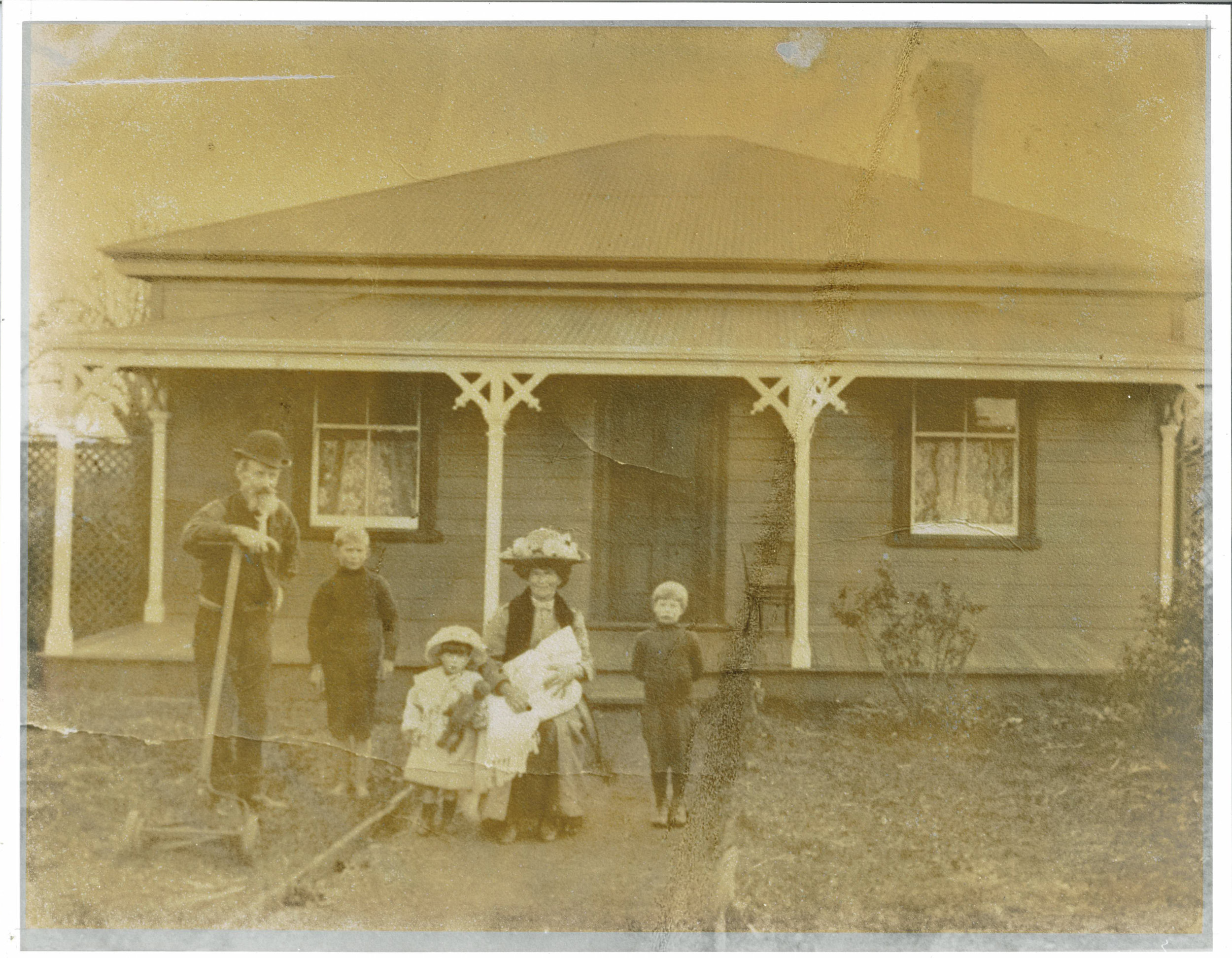 Unknown family standing outside their family home on Pilkington Road. Image Credit Ian and Tracey Neary. Date unknown.
