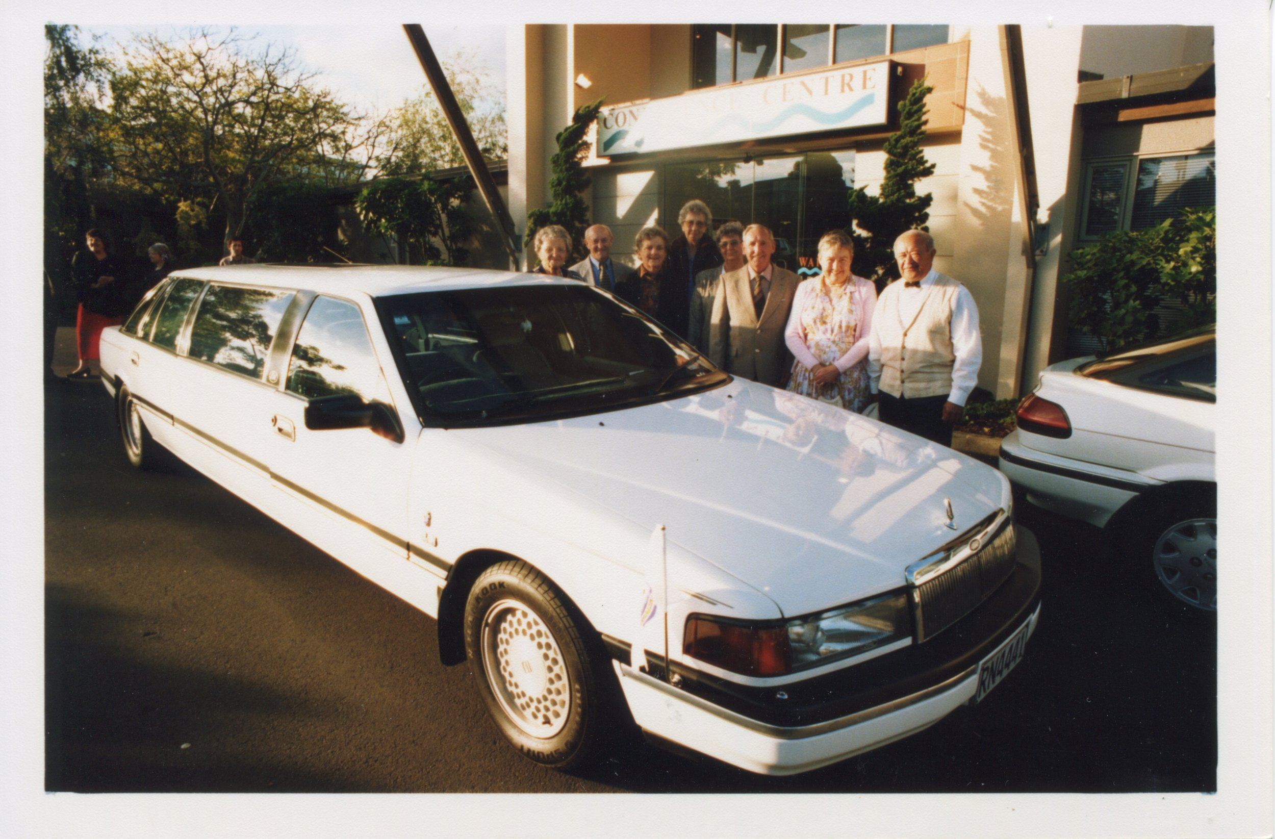 Group standing with their limo. Panmure 150th anniversary celebrations. Image courtesy of Panmure Business Association.
