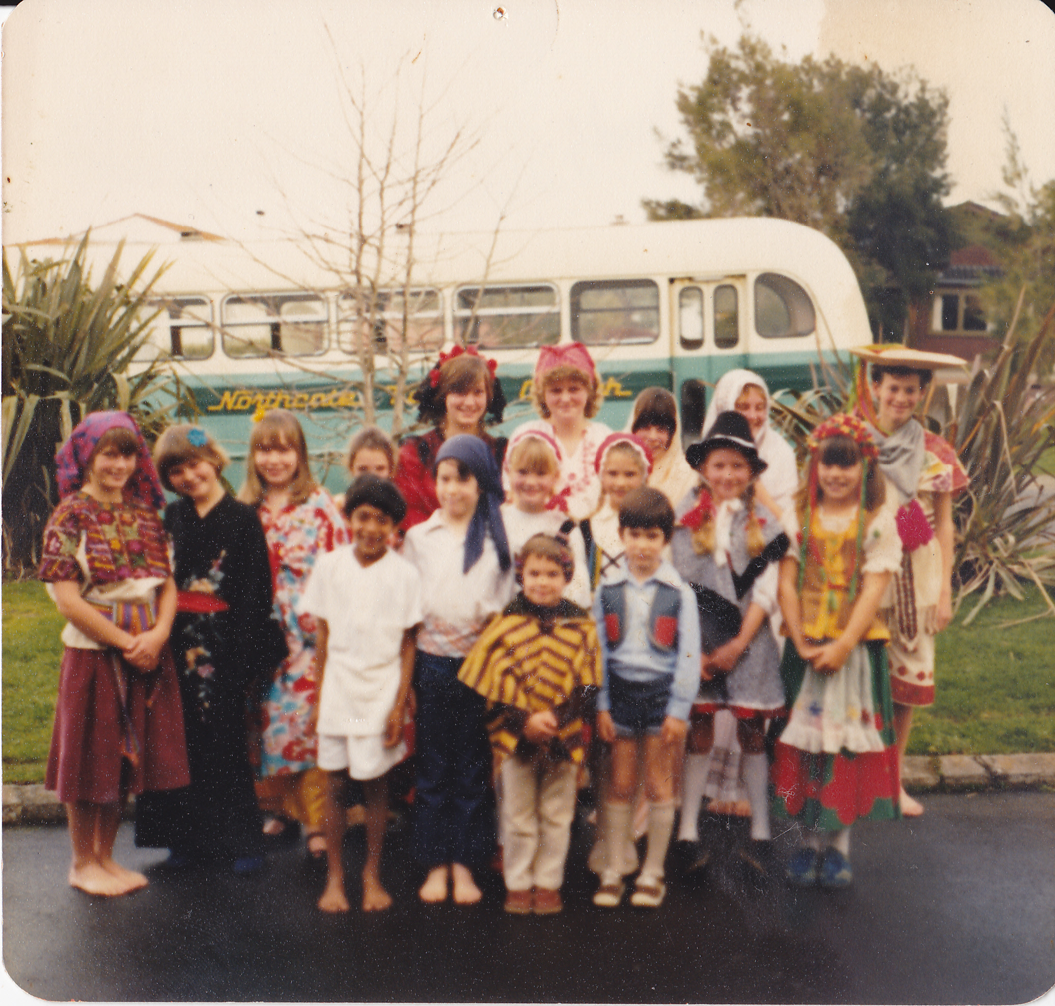 Group of Sunday School kids in front of Church bus. Image credit: Janice Norton. Early 1980's.