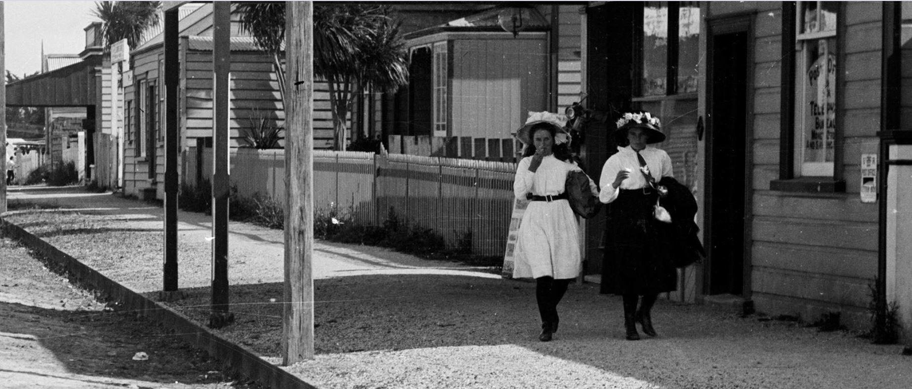 Ladies walking down Queen Street with the Tavern in the background. Image credit: Kim Milne. Late 1930s.